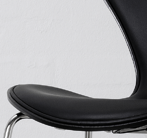 Series 7 Chair Front Upholstered - <p>Designed by Arne Jacobsen in 1955, the Series 7 chair is a further development of the classic Ant chair.<br /> The four-legged Series 7 chair represents the culmination of the pressure-moulding technique that Søren Hansen, founder Fritz Hansen's grandson, spent the 1920s and 30s refining.<br /> The iconic shape of the Series 7 is the result of Arne Jacobsen's exploration of the possibilities of steam-bent veneer.</p> <p>The best selling chair in Fritz Hansen's history comes in 3 different finishes: Natural veneer, coloured ash or lacquered.<br /> All chairs are made of pressure moulded sliced veneer with a base of chromed steel.<br /> The shell is also available in front- or fully upholstered versions in a wide range of fabrics and leather types.</p> <p>A range of materials and colours are available in a number of combinations. Prices may vary.<br /> Please enquire for full details.</p>  | Matter of Stuff
