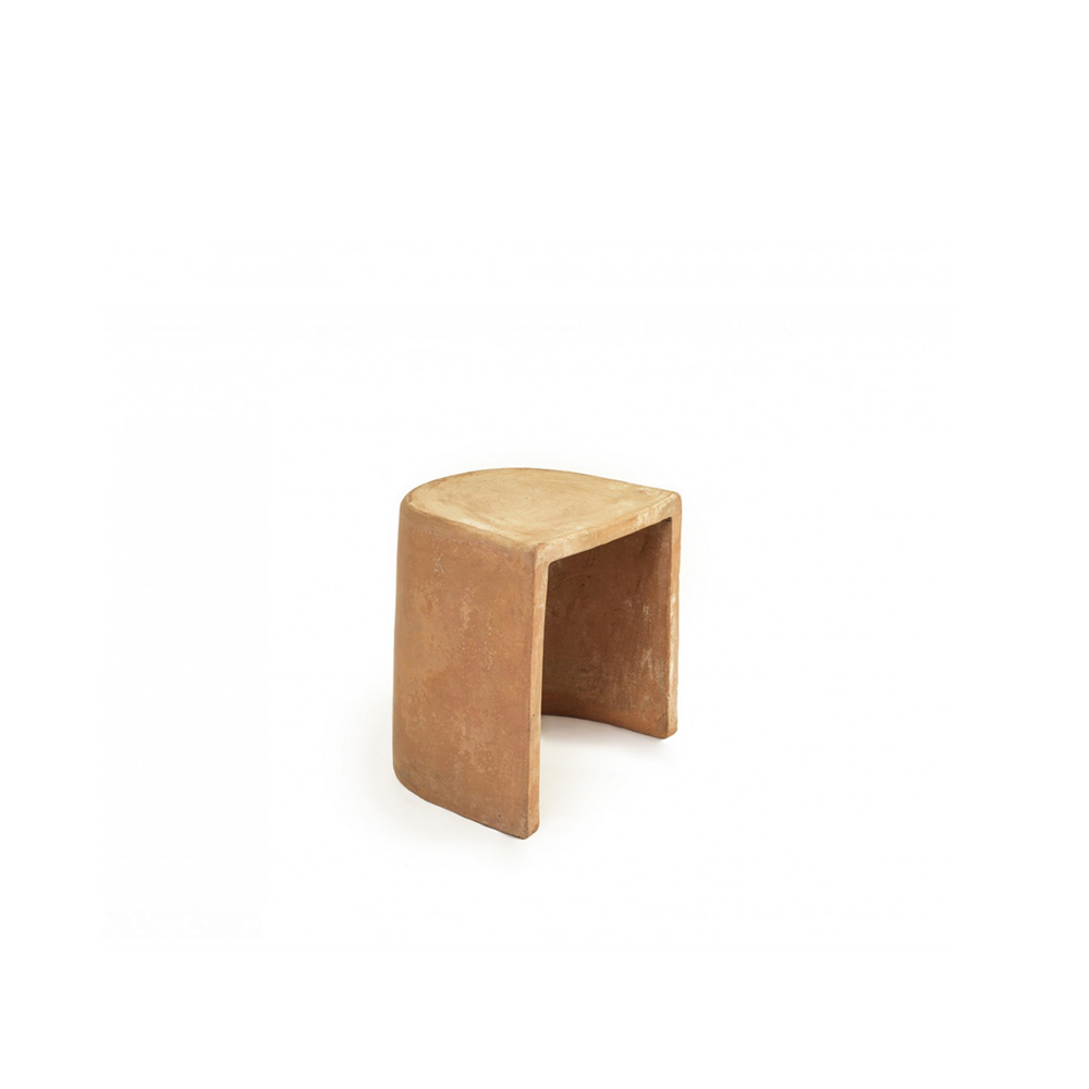 """Cave Stool - Cave is an informal terracotta seat designed for outdoor spaces. The choice of this natural material inspired the designer Mario Scairato to create """"an object that can exist in symbiosis with nature, tamed or otherwise, but above all can take on charm, ageing gracefully while freely braving the elements.  