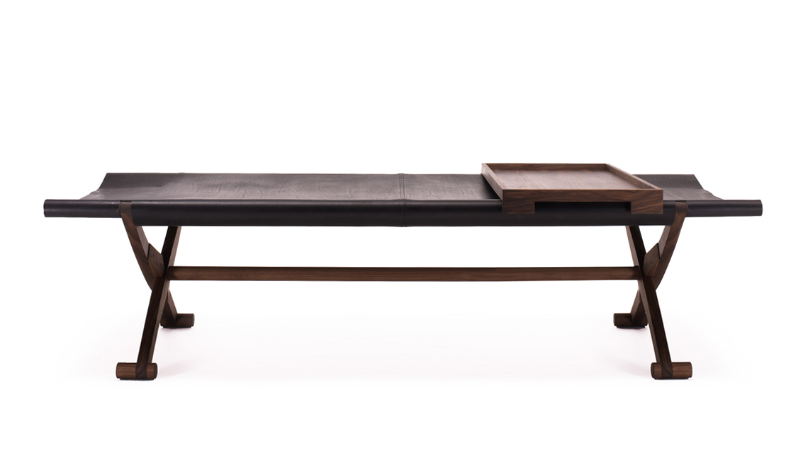Branda Camp Bed - <p>This project goes back to the dawn of time and, probably, it was originally a travel bed. Made from solid black walnut and ashwood, the seat, suspended, can be in full-grain leather, frosted leather or fabric 100% cotton. Branda can be folded and set aside in a small room for later use.</p> <p>More colours and Wood on enquiring.</p>    Matter of Stuff