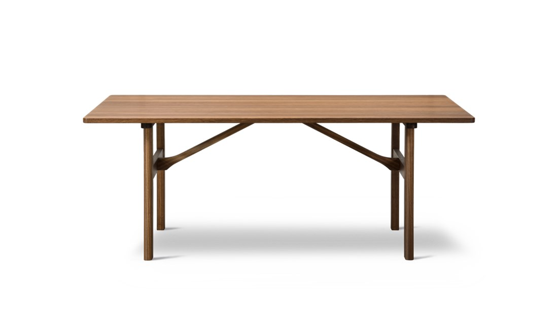 Mogensen 6284 Dining Table - Designed in 1958, this dining table is constructed from the finest selection of solid oak. Also available with additional plates extending the tabletop by 40 cm at each end.  Practical, durable designs to enrich people's everyday lives. That sums up the essence of Børge Mogensen's overall intention with his work. Referring to wood as his preferred material, Mogensen designed an array of pieces noted for their sober expression and superb sense of proportion.   Mogensen applied the same principles to his iconic series of tables, appreciated for their clean, uncluttered lines inspired by the functional, utilitarian approach of the Shaker movement.   All our Mogensen tables reflect his ambition to create beautiful, distinctive furniture by emphasising simple horizontal and vertical lines and surfaces. A restrained aesthetic with a modest appearance intended to create a sense of tranquillity.   All of which makes the Mogensen tables an ideal choice for any gathering you can imagine. From corporate settings and meeting rooms to group dining and socialising. | Matter of Stuff