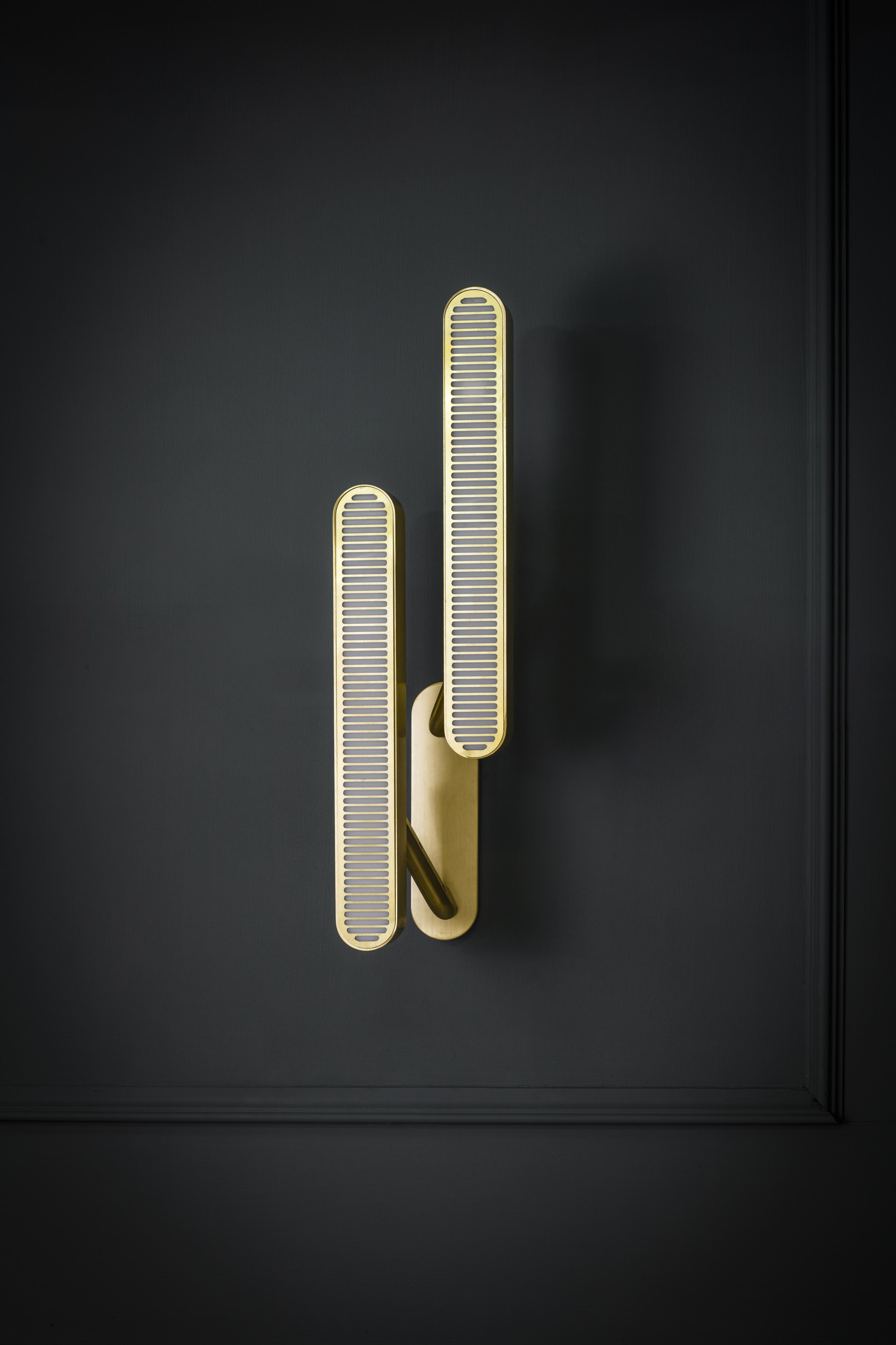 Colt Wall Light - Double - <p><span>With two slender opposing arms, the Colt Double Wall Light will lend sophistication to any room. Matching machined brass grills filter light from opal diffusers and echo the elegant curves of the brass wall plate. </p> <p></span></p>  | Matter of Stuff