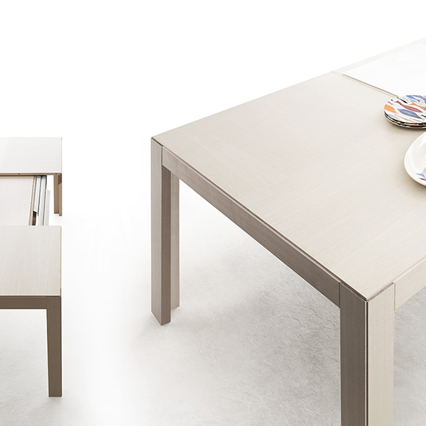 "Edo Extendable Table - <p>Sobriety and elegance to live every day. The care for details and the neat lines characterise ""Edo"", which, in only one move transforms itself from normal dining table into a large one for family meetings, reaching the length of over 3 meters.</p>