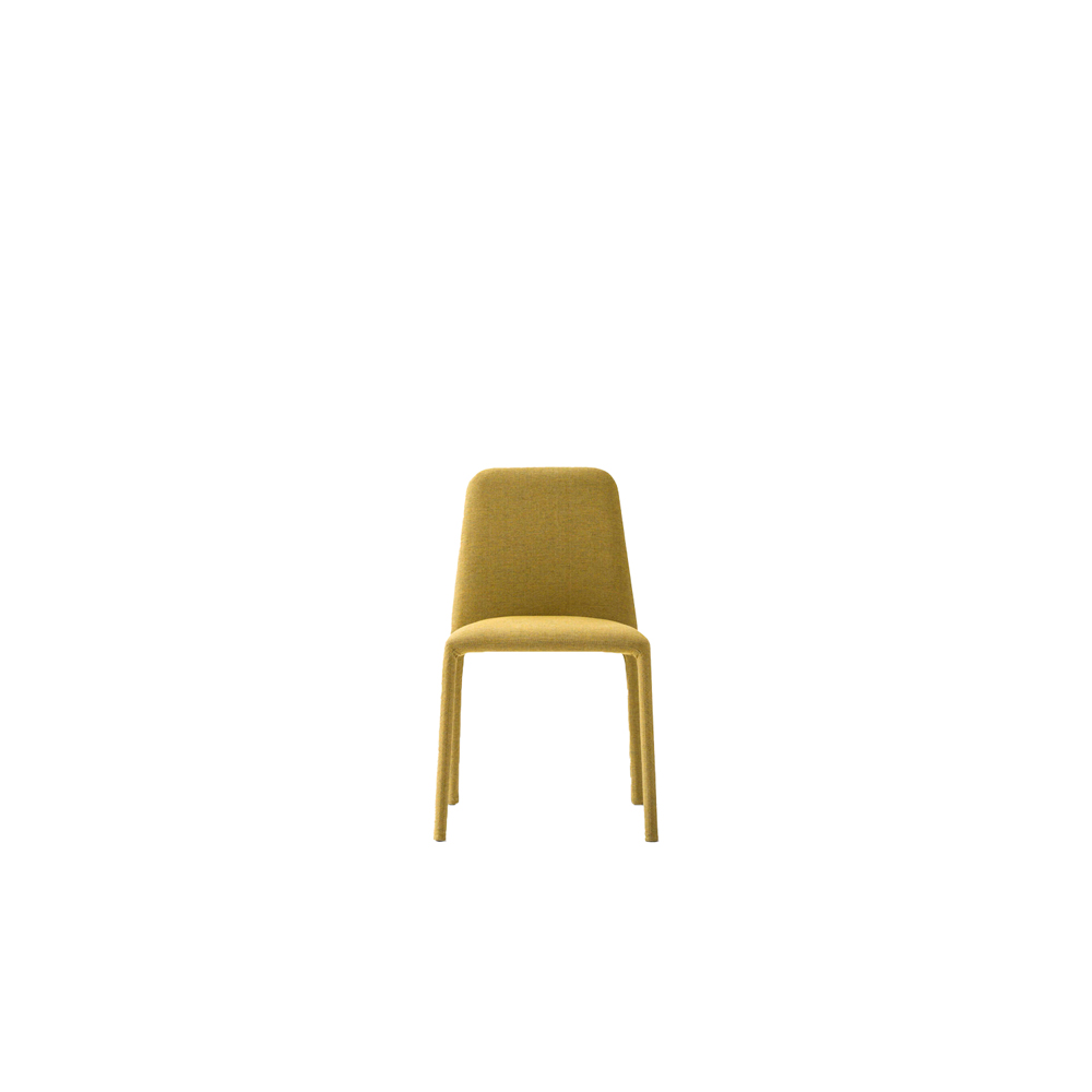 Time Chair  - Stackable and featuring removable upholstery, the Time chair features a dainty silhouette. The frame is padded and covered from head to toe with fabric, imitation leather or extra leather: a feature that provides both visual interest and a soft, warm tactile appeal.  | Matter of Stuff