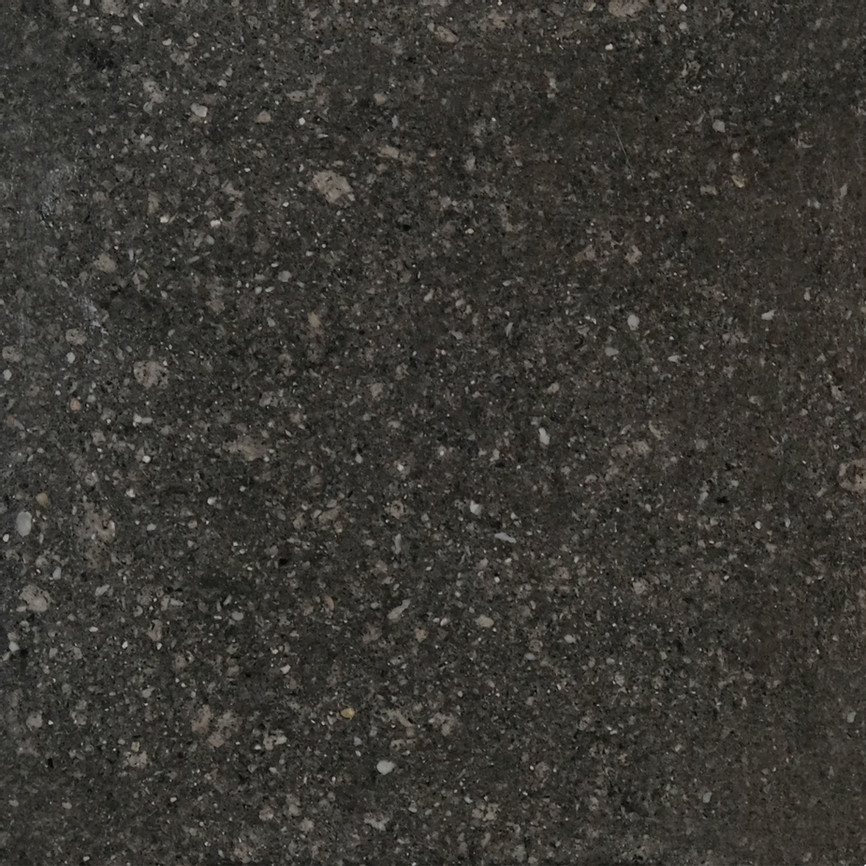 Stone Black SeaStone Plain Tiles - Sea Stone is a sustainable material that is composed of natural, non-toxic ingredients and binders.  Every year, 7 million tons of seashells are discarded by the seafood industry and aquaculture. Even though some of the seashells have been recycled and used as fertilizers, the majority of them are being thrown into landfills or by the seaside. The discarded seashells which are uncleaned or rotten have not been cleared away at all and have been piling up near the beach for a long time, thus, causing odour pollution and polluting the surrounding land in the long run. Yet, these shells are materials with high potential,which consist of over 90% calcium carbonate,containing similar to the one of what calcium carbonate in the limestone contains and seen as a valuable biomaterial Project 'Sea Stone' proposes the use of discarded seashells to create environmentally and economically sustainable material rather than contributing to the world's rubbish problem. The method is currently carried out manually to avoid the use of heat, electricity and chemical treatments and ensure the process is a sustainable and affordable as possible. Moreover, it is expected to positively impact three effects such as reducing waste disposal costs, preventing marine pollution, and recycling waste by creating value-added products with artistic, aesthetic, and functional new uses | Matter of Stuff