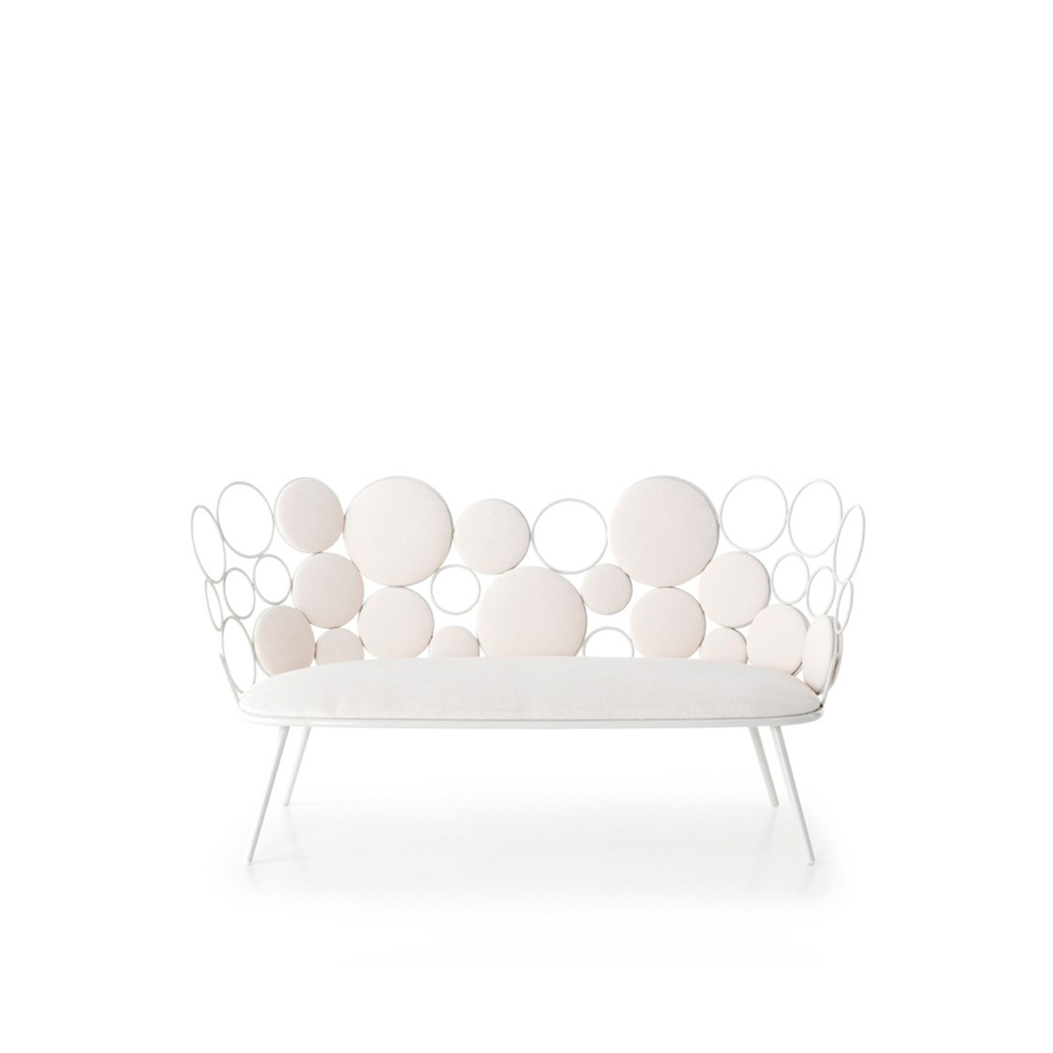 Grace Garden Sofa - Grace is a fabric and iron garden sofa, part of the homonymous collection.  Our new outdoor collection by Paolo Grasselli is an irresistibly dainty decorative range.  Geometric patterns materialise and metal lines trace circles through the air in an artistic élan that is much more deliberate than first seems.  Metal rings of differing sizes breathe life into a seating collection and accessories where practicality and beauty become one. Empty circles clasp cushioned spheres in a cluster of coloured and transparent bubbles, settling down magnificently into a tub chair, a loveseat, a low table and a pouf. Nascent forms spring up where the concept of a chair has been torn apart and made whole again; yet this time, the distinction between space and matter and object and surrounds has become blurred. Depending on the arrangement of the rings and the positioning of the cushions, different harmonious patterns can be created - the end result will always be strikingly decorative and surprisingly comfortable.    Materials :  Coated outdoor structure with spheres in ø 8 mm solid iron rod, ø 18 mm tubular base, available either in white or grey.  Padded spheres made in Finnish spruce and a seat cushion in contoured rubber are available in a vast array of upholstery suitable for outdoors. Should the furniture be destined for indoors, the choice of upholstery fabrics includes the home collection.  | Matter of Stuff