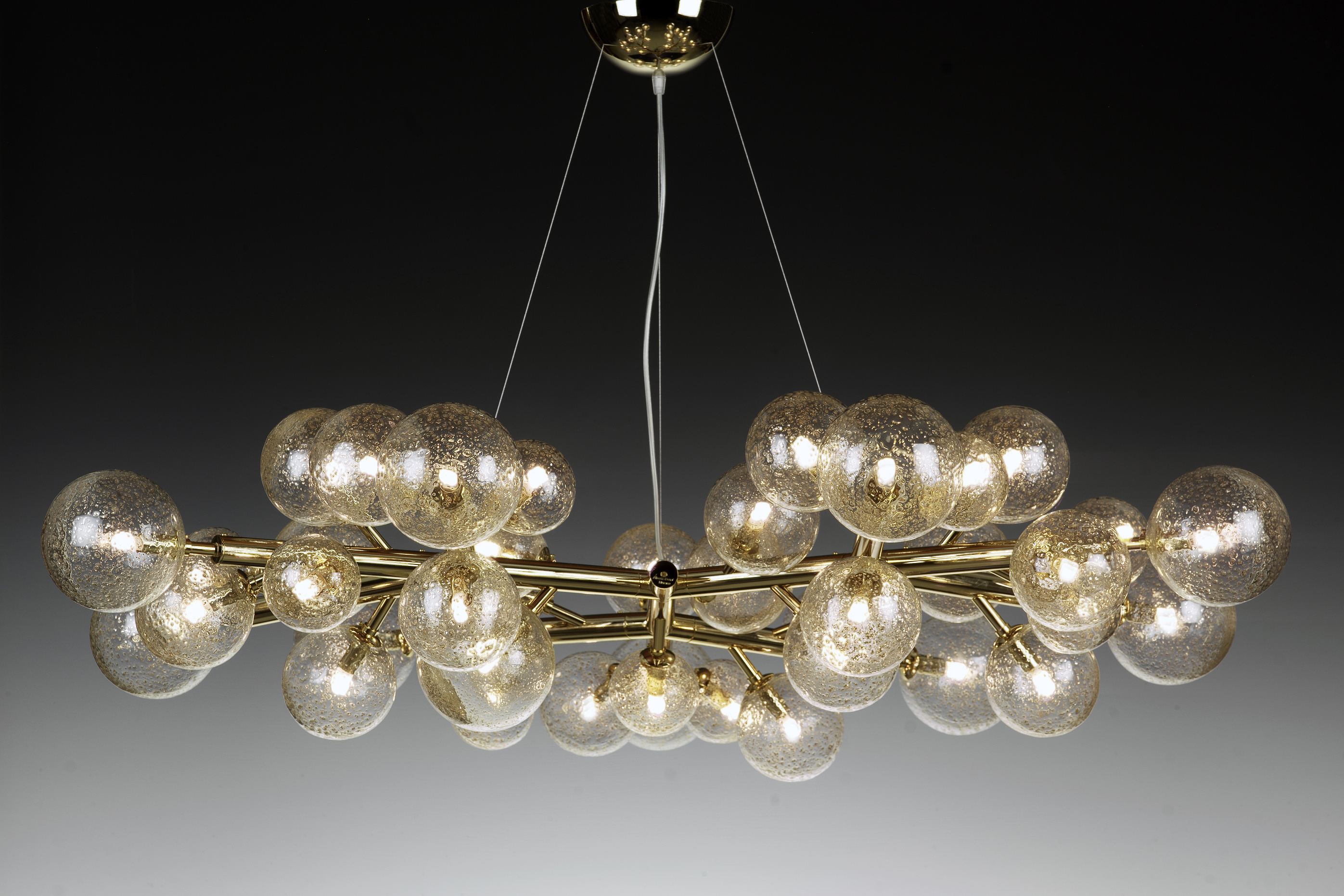 Mimosa 42 Brass Chandelier - <p>This chandelier, designed and realised by the glassmaster Alberto Donà , is totally different from our classic collection. Its peculiarity is the simplicity of the frame decorated with 42 glass spheres – that during blowing are decorated by the master adding  gold, copper or brass powder. The result is a simple but impressive chandelier especially when lighted. Each sphere has a G9 2.5w bulb. Chandeliers are available in different sizes.</p>  | Matter of Stuff