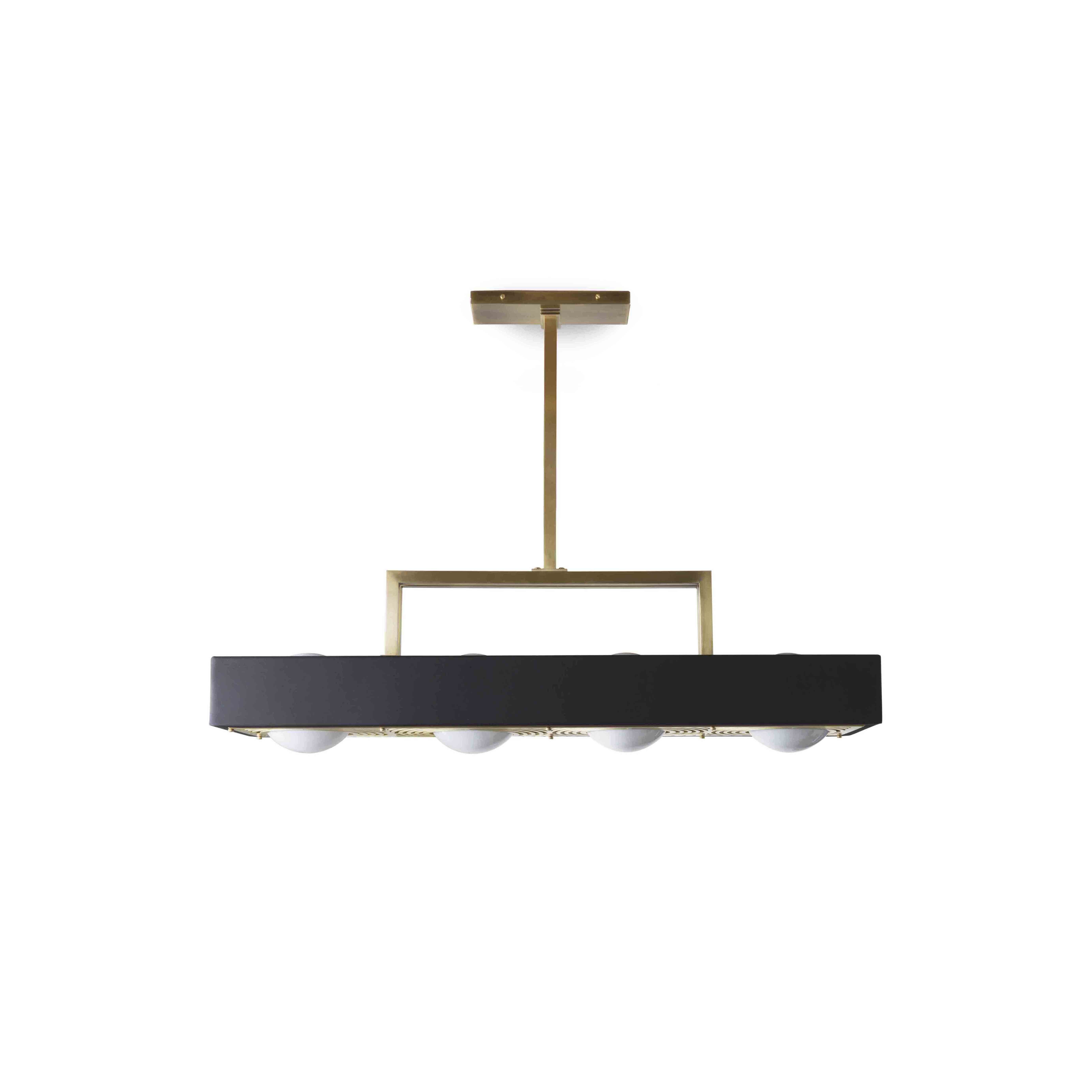 Kernel Pendant Lamp - With four opal glass globes highlighting a laser-cut brass diffuser the Kernel Pendant Lamp will bathe any surface in soft light while also emitting a gentle up-lighting glow.    Matter of Stuff