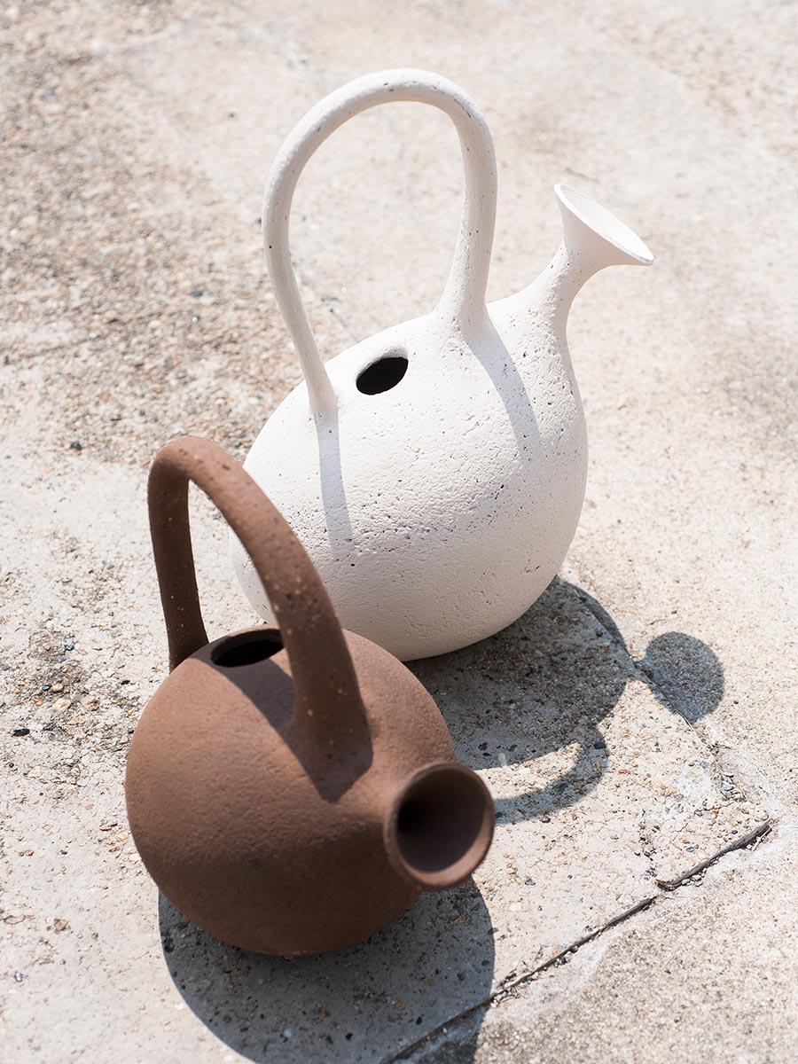 Aqua Regis Vase - The Aqua Regis amphora takes its name from the famous liquid named by alchemists for its ability to dissolve gold. Thrown on a potter's wheel and made of engobed semi-refractory, the amphora is a rounded structure with a single, large lateral handle and ample footed base. | Matter of Stuff