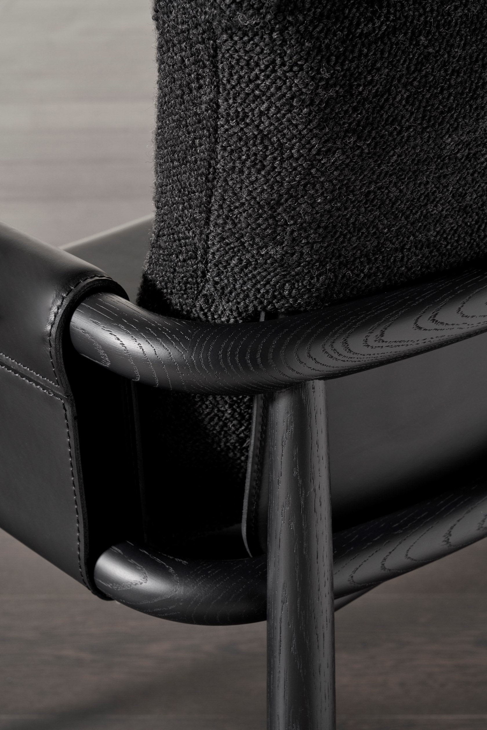 """Teresina Imbottita Armchair - Two souls enclosed in the same body: Teresa and Teresina are an armchair and a chair marked by essential lines that take shape and structure thanks to the warmth and solidity of oak wood, skilfully crafted. Both comfort and aesthetics differ in the available versions, """"soft"""" or """"kuoio"""".  The first one is softer and more welcoming, with padded back and seat covered with the textiles and leathers in collection. A special seam with double ribs reveals here the tailoring approach of Meridiani.  The second version takes on a more gritty and decided look thanks to a saddle-leather body that defines back, armrests and seat: the particular saddle leather shape bound up to the oak frame draws a suspended seat that emphasizes its rigor.  This is how this collection recalls different suggestions depending on the finish and color chosen, creating versatile seats able to dress up and interpret every living context. 