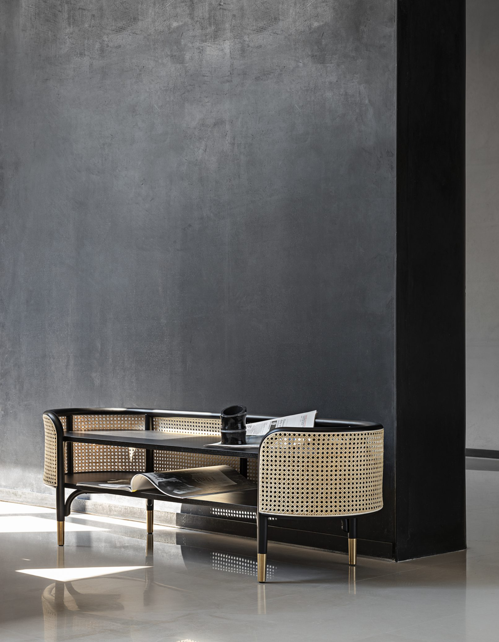 Mos Bench - Sleek and delicate, the Mos Bench comes into its own when you notice the attention to detail, such as the woven cane shell connecting the seat to the legs, accented with brass feet. Made from bent beechwood, the bench features open-pore painted ash, with an upholstered cushion. Also available with a shorter seat cushion and exposed bench surface. | Matter of Stuff