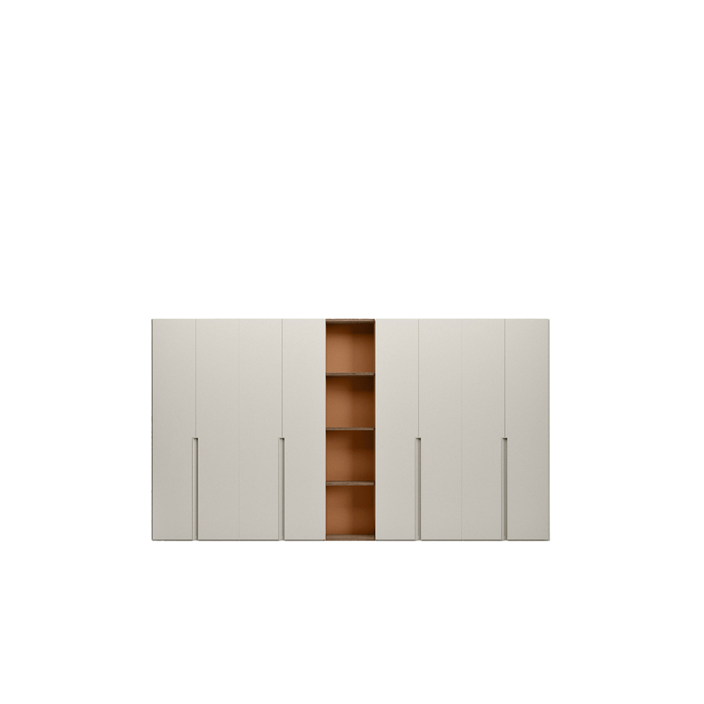 Unika Hinged Door Wardrobe - Unika's handle recessed into the side of the door is the detail that sets this wardrobe apart from the other hinged door models. Available in two sizes – running all the way to the floor or shorter – it can be customized in any of the matt lacquered colours, to match or contrast with the door.    Matter of Stuff