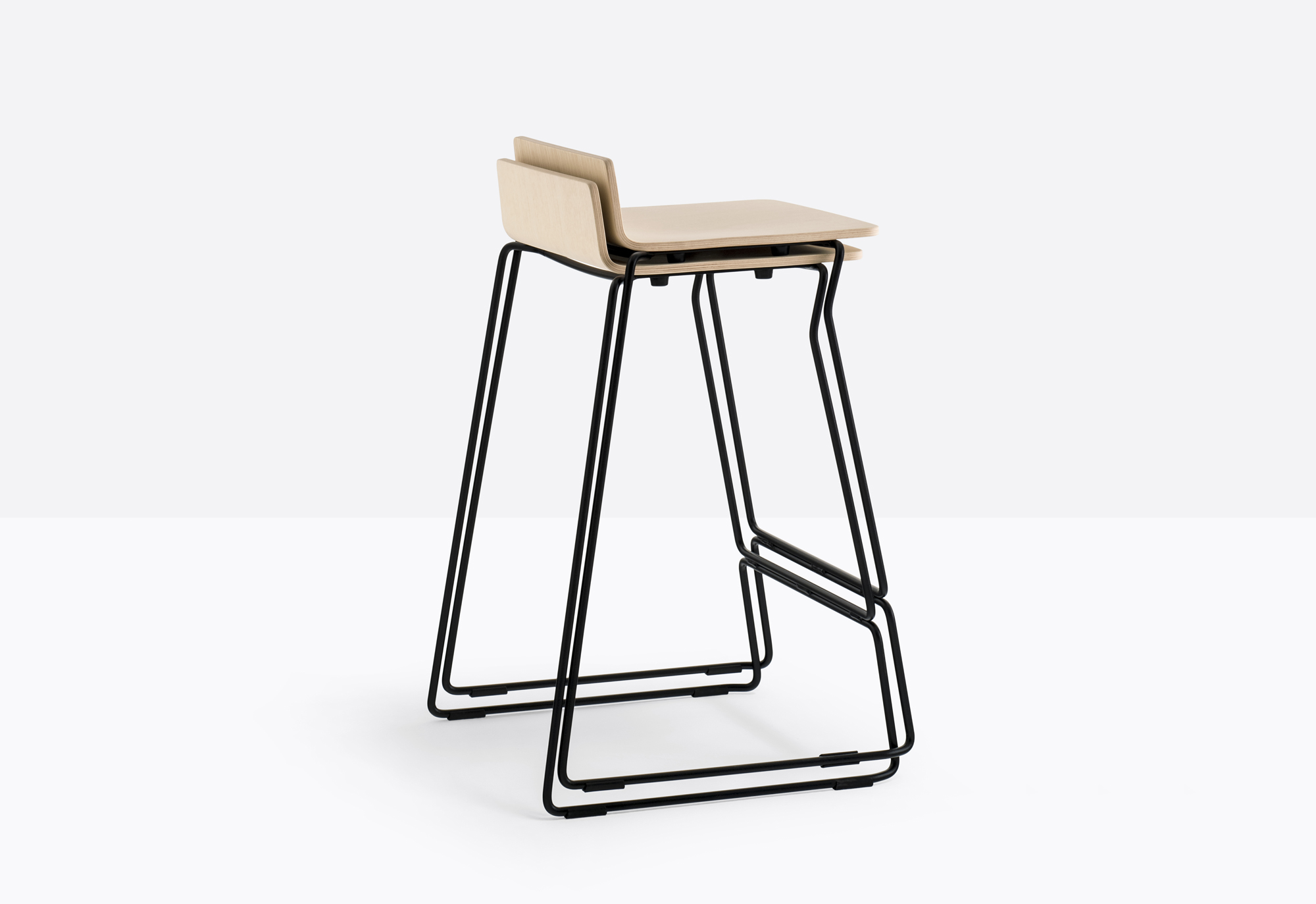 Osaka Metal High Barstool - Osaka is a collection of seatings with a strong graphic impact whose construction elements remind the linear features of an ideogram. Osaka Metal barstool with ash plywood shell and steel rod sled frame Ø 11 mm. Seat height 750 mm. | Matter of Stuff