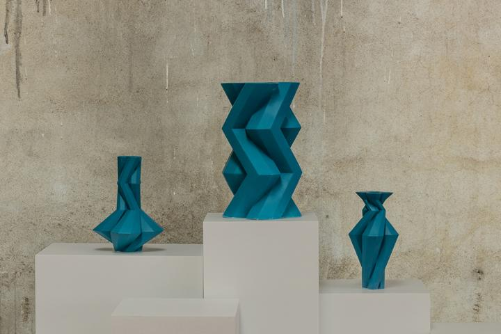 Fortress Spire Blue - <p>Designer Lara Bohinc explores the marriage of ancient and futuristic form in the new Fortress Vase range, which has created a more complex geometric and modern structure from the original inspiration of the octagonal towers at the Diocletian Palace in Croatia. The resulting hexagonal blocks interlock and embrace to allow the play of light and shade on the many surfaces and angles. There are four Fortress shapes: the larger Column and Castle (45cm height), the Pillar (30cm height) and the Tower vase (37cm height). These are hand made from ceramic in a small Italian artisanal workshop and come in three finishes: dark gold, bronze and speckled white.</p>  | Matter of Stuff