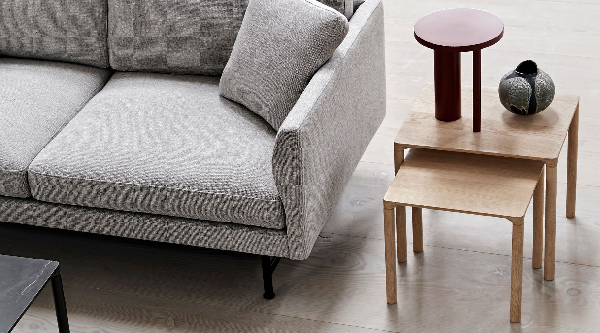 """Piloti 6705 Side Table - iloti is a series of solid oak side tables. The subtle detailing of the table top creates the impression of a single line, floating between four delicate legs. The tables are supplied in two heights and can be combined as a nest.  The word """"piloti"""" refers to the pillars or columns that elevate a building above the ground. While the legs of our Piloti Tables resemble pillars, the overall intention is for the table to appear like a slim line almost floating in space.   An elegant integration of the table top with the legs ensures a subtle, streamlined transition into one balanced entity.   Light in appearance yet sturdy in construction, the Piloti tables in wood are made from solid oak, a naturally beautiful, tactile material that needs no adornment. The option of different sizes gives you the freedom to cluster the tables together in a corner or as part of a sofa set-up. Place them individually as side tables or as a matching pair on either side of a bed.  