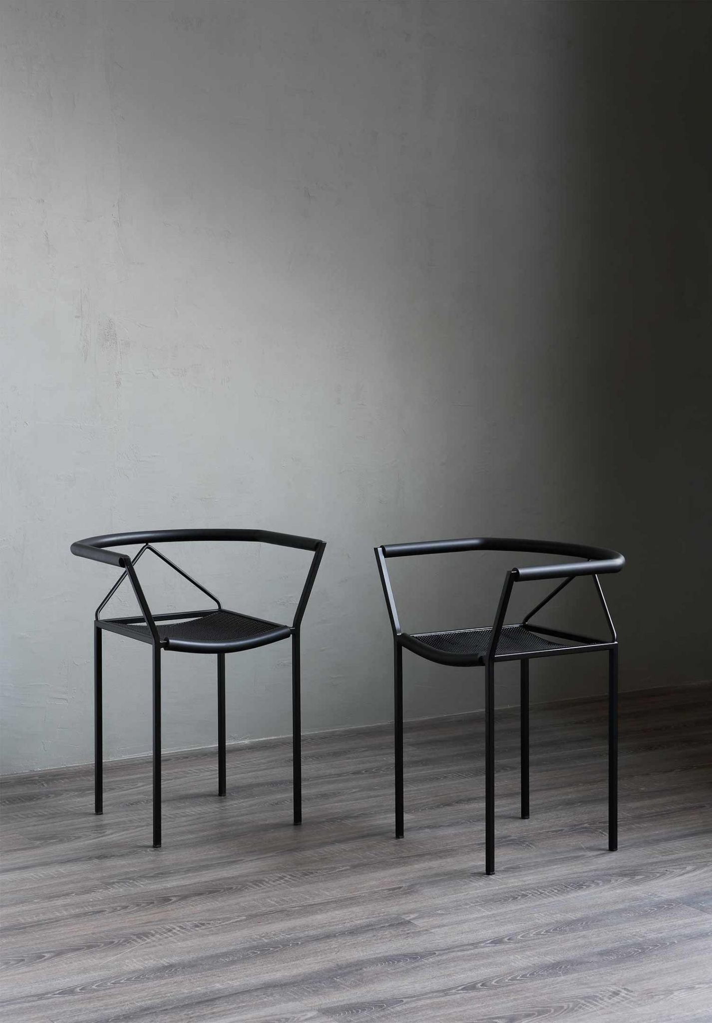 Poltroncina - The Poltroncina armchair is a unique take on the normal form of an armchair. Designed in 1984 by Maurizio Peregalli this armchair is elegant while having a striking angular structure. It has a steel square tube frame (15 x 15cm) ,which is embossed black, with seating in thousand points rubber, all black. | Matter of Stuff