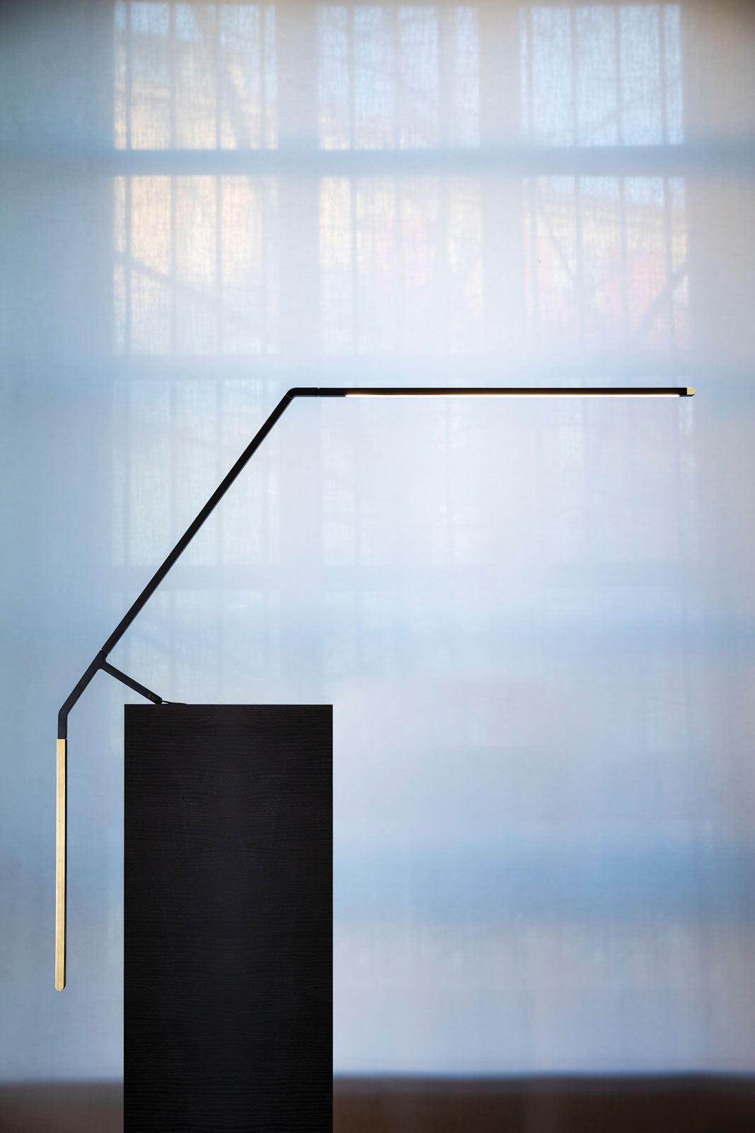 Bird Table Lamp - <p>Table LED lamp in extruded aluminium with T-shaped support in polymer filled with glass fibres. Composed of a protruding matt black painted arm where the light source is located and a vertical brass counterweight. The lamp, placed freely on the edge of a surface, oscillates and moves but always returns to the horizontal position. The LED module incorporated in the arm rotates around its own axis, making the lamp versatile providing diffused direct and indirect lighting. Switching on and dimming through a proximity sensor.</p>    Matter of Stuff