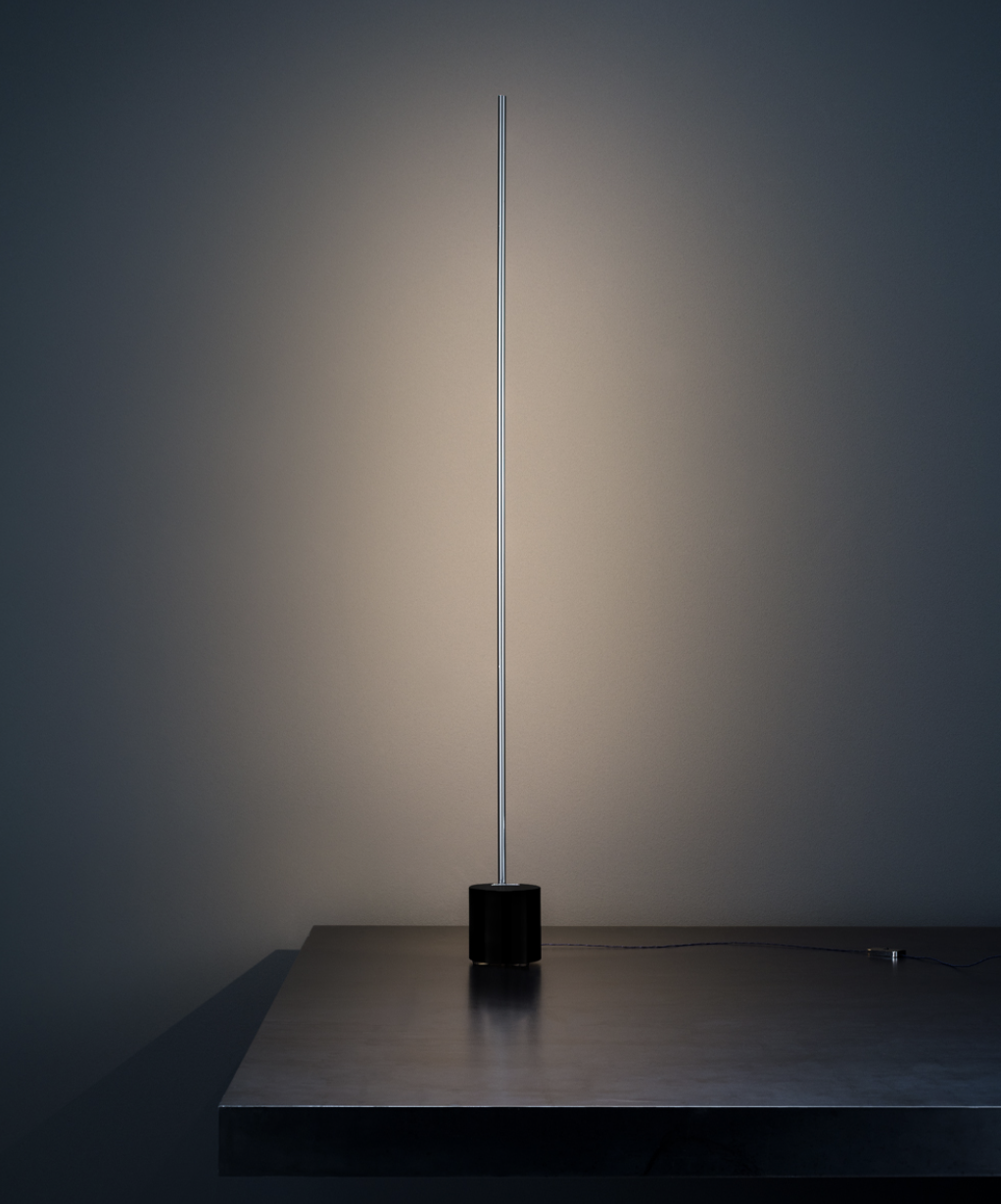 Light Stick T Table Lamp - When Enzo Catellani began creating new lighting fixtures using the first LED circuits, the intention was to create simple, discreet, almost invisible objects, that put emphasis on the light. This is how he moved away from a rather 'aggressive' style towards simple minimalism. | Matter of Stuff