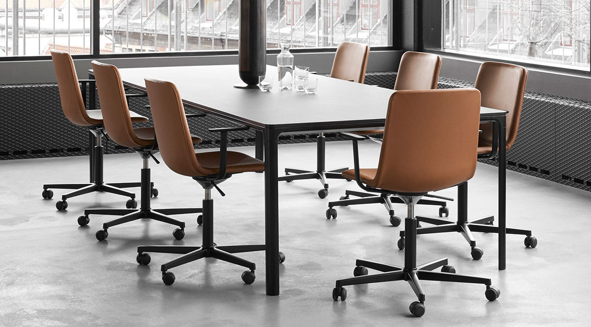 Pato Executive Swivel Armchair Fully Upholstered - Full upholstered conference chair with arms, mounted on a 4-point swivel base. The chair has a higher back than the standard Pato shell, giving a powerful visual character. Pato Executive is a natural choice for a meeting and conference chair.  With the Pato series, Fredericia's legacy of immaculate detailing and craftsmanship meets today's industrial standard - the multipurpose plastic chair. The human-centred design is the work of Danish-Icelandic design duo Welling / Ludvik. Presented in 2013 after nearly three years of development, Pato sets a new standard for the execution and finish of polypropylene material. The series meets every possible contemporary demand for home, office, and public spaces and is available in upholstered versions for extra comfort and different visual statements.  MADE IN DENMARK Pato's polypropylene shell is produced completely in Denmark. Engaging close collaboration with local subcontractors, Fredericia has complete control over all stages of production. All chairs are assembled and quality controlled at our factory in Fredericia.  ECO FRIENDLY Pato is produced in environmentally friendly polypropylene and steel. With it's shell manufactured in Denmark and all other assembly in Denmark as well every chair is fully quality controlled during all stages of the manufacturing process.   The frame is made from quality steel and surface treated with solvent-free powder coating or chrome-plated with Chrome3. The chrome plating complies with lacquer coating standards (DS/EN ISO 1456), thus eliminating any risk of nickel allergy.   At the end of its life cycle, the chair can easily be disassembled for sorting at source. All components are 100% recyclable and can be incorporated into future furniture production.  SUBLIME FINISH AND DURABILITY The chair is tested for durability at the Danish Technological institute and passes at the highest level (Hard use in public spaces). The Pato Shell has a 