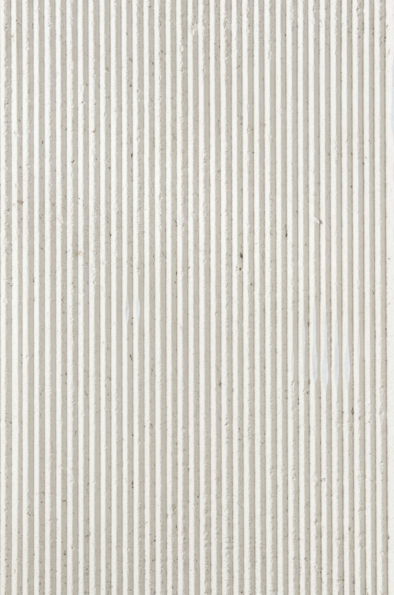 "White Medium Ruts - Obtained by stretching the impasto first by hand and then with CNC machining, Ruts alternates between flat portions, reminiscent of stone, to rectangular sections to create a succession with a solid and fortunate rhythm. The ""cadence"" of its grooves can be more or less dense, continuous or interrupted, but in each of its versions and in all the different colors, Ruts reveals, thanks to the intervention of the machine, the material uniqueness of paper pulp. They are indeed hard, mechanized cuts that speak of the very fiber of the paper as it pushes toward new dynamic and formal borders. 