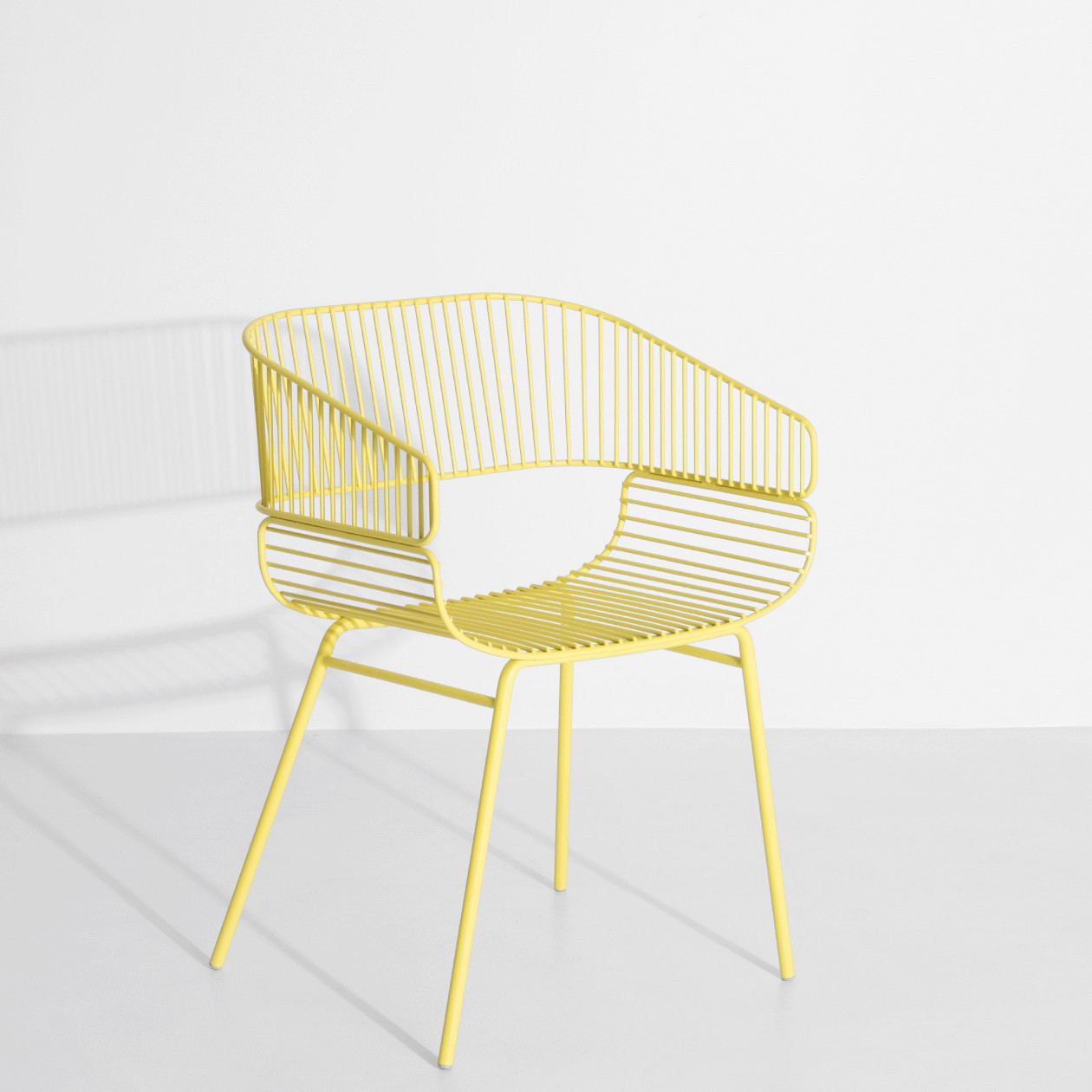 Trame Armchair - Amandine Chhor and Aïssa Logerot sign a new creation for Petite Friture: an armchair with a light and enveloping aspect, that associates curves and rhythms to combine comfort and strength. A cushion can be added for indoor use. A-frame that stretches along two main tracks, coming together to create the seat and back. Taking its place in both interior and exterior the Trame chair plays with opposites of lines and tensions on curves, all in softness, the perception of comfort on a light structure, an air like appearance for a solid chair.    Matter of Stuff
