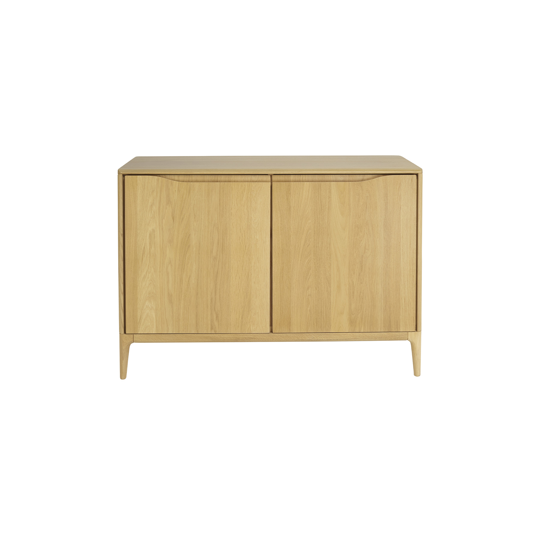 Romana 2 Door Sideboard - Romana is a modern dining and living-room furniture collection with soft curves and sophisticated craftsmanship that emphasises Ercol's skill in working with solid timber. Romana is made from pale oak and finished in a clear matt lacquer to both protect the timber and show off its beauty. This oak sideboard has two separate storage cupboards providing plenty of storage space.  The front edge of the sideboard top bears the signature soft curve, and the legs have the fluid organic curves and chamfers, that characterise Romana. The cupboard sections each have a wooden shelf mounted on pins and can be adjusted in height. The door hinges have soft-close mechanisms to give a gentle shut.