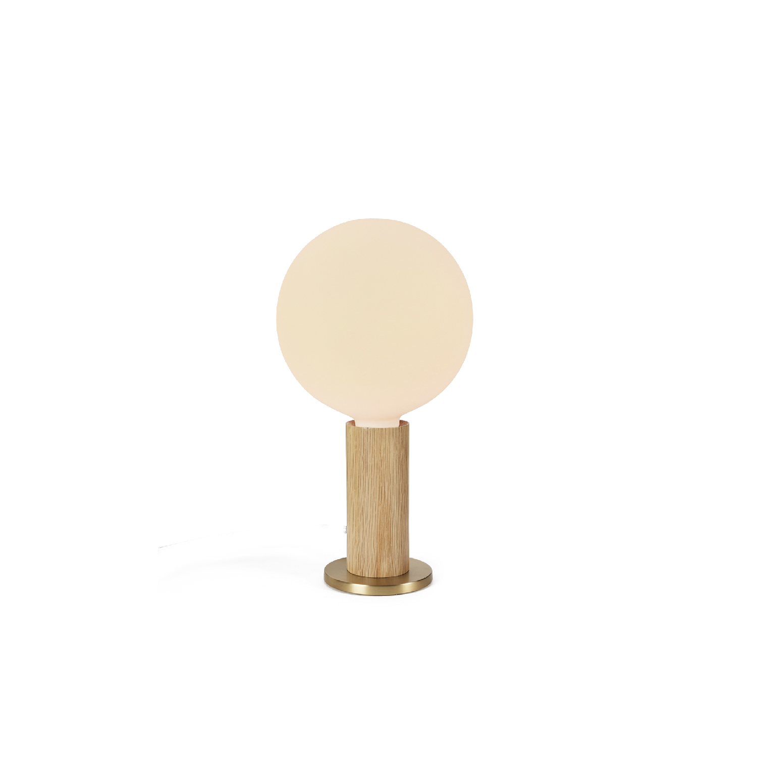 Oak Knuckle Table Lamp  - Honouring a truth to materials, the Knuckle Table Lamp is designed to promote the beauty of the light bulb through its simple and honest form.  Combining a cylinder of blonde coloured oak with a satin brass-finish base, it comes complete with a tactile in-line dimmer to achieve the maximum dimming performance from any Tala LED bulb.  Versatile and accessible, the Knuckle Table Lamp ideal for decorating a desk, shelf or bedside table.  Features – Bulb not included – Light-coloured solid Oak – Minimal waste production – In-line dimmer – 3m grey braided PVC cord – Weighted, tilt-resistant base – Satin brass-finish detailing | Matter of Stuff