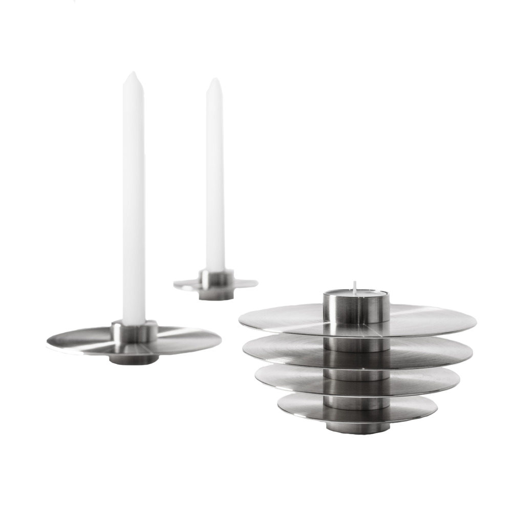 Modern ORB Candle Holders Set CS2 Stainless Steel - ORB is a set of seven metal candle holders stacked on top of one another to form a modern spherical sculpture. Designed to be functional, each candle holder has two sides to hold long and tealight candles. The collection comes in solid brass and stainless steel making it look charming in any interior setting as a series of seven candle holders or as a single sculpture.