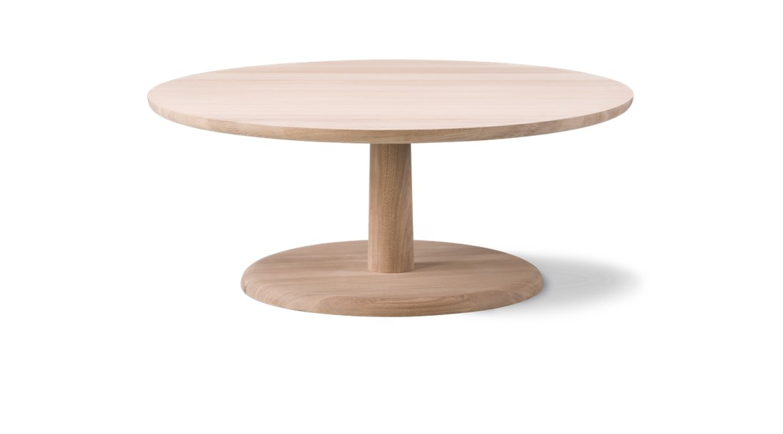 """Pon 1295 Coffee Table - Pon is a series of solid wood side tables in different sizes that are both very stable, versatile and which can be used as either stand-alone furniture or combined in different heights. The smaller Pon tables are modest in size, but large enough for a book, a glass or a tray.  British Jasper Morrison is known for creating simple, functional items fundamental to everyday life. A process that questions what's essential in a design and what's not, based on the ever-changing way we live our lives.   Morrison describes Pon as an alternative to the """"overrated and badly named 'coffee table.'"""" Why should a coffee table take up space, when it could be several small tables placed as you like? Pon gives you options for customising your own table solution.   Circular in shape and modest in size, Pon comes in varying heights which you can place in countless configurations. It's equally appealing as a side table, ideal for a laptop or tablet, a book or magazine, a drink or a snack. Use it as a stand-alone beside a lounge chair or grouped together in a sofa set-up.   Adding to Pon's versatility is its stability. Made of solid oak, Pon was designed with the top, stem and base combined to form one solid entity. A unique feature that opens up opportunities for this endearing, robust design to find a home in hotel lobbies, art galleries, retail spaces, restaurants, bars and the like, as well as domestic settings.  