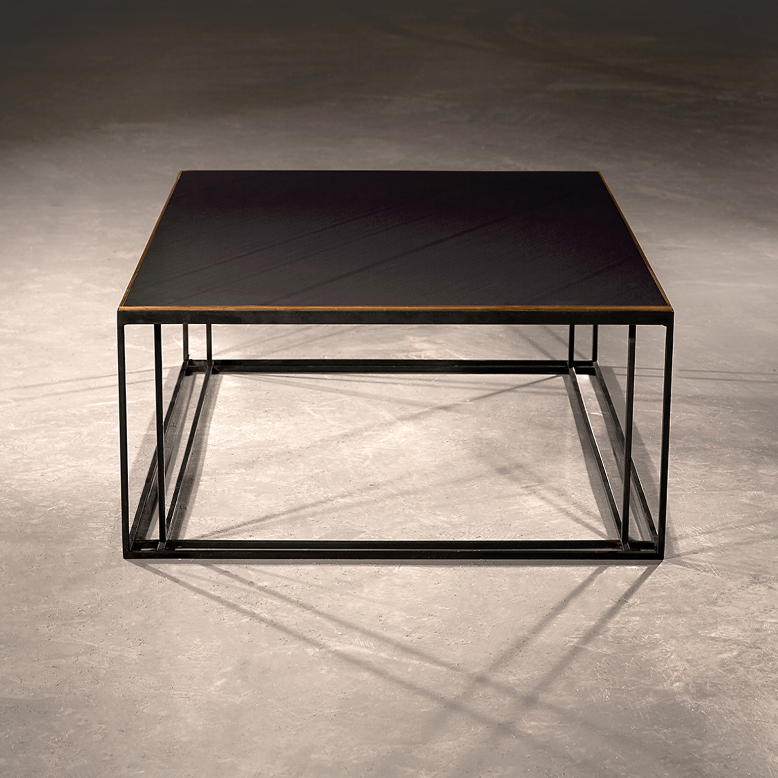 Slate Binate Coffee Table - This coffee table is the perfect height to be in the centre of a lounge or living room or in a casual commercial area. The choice of finishes means that you can choose the best one to suit your space. The frame is Blackened Steel and the Top is honed Cumbrian Slate, with a Polished Brass Trim. This table is hand made and crafted in the North of England to order. Custom sizes and finishes are available.</p>    Matter of Stuff