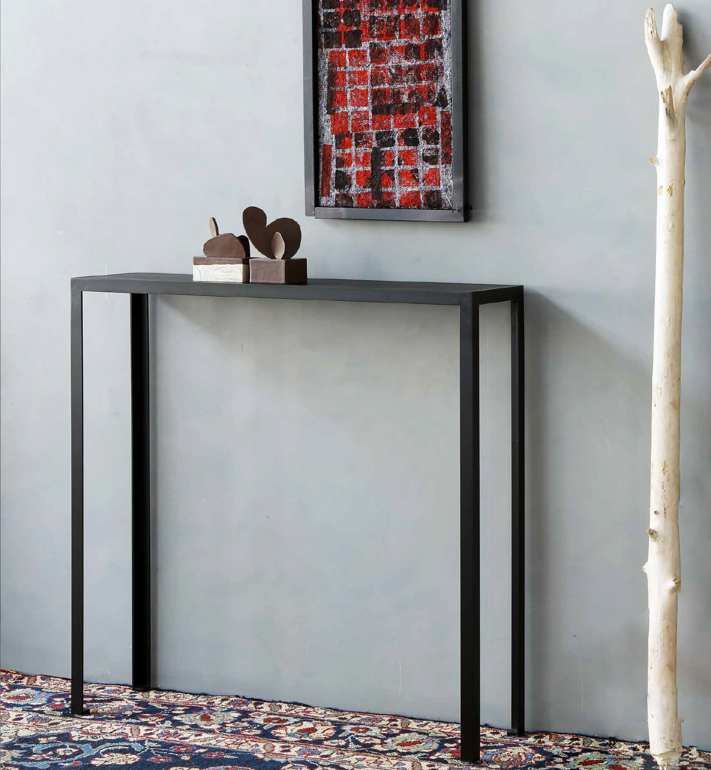 Console Slim - Console slim was designed by Maurizio Peregalli. It is a high console and is a perfect addition to hallways and walkways as well as in the lounge or dining room. It has a steel frame with iron drawn angles. The Console Slim is epoxy painted semi opaque black and is encased top in black linoleum | Matter of Stuff