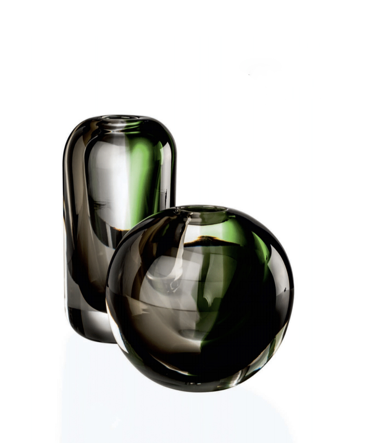 """Milano Vase - Transparent Crystal with hints of Apple Green and Grey. Broad avenues, stately residences flanked by lush vegetation: this vase speaks of the essence of Milan. A celebration made all the more special by the use of the """"Sommerso"""" technique on blown glass. 