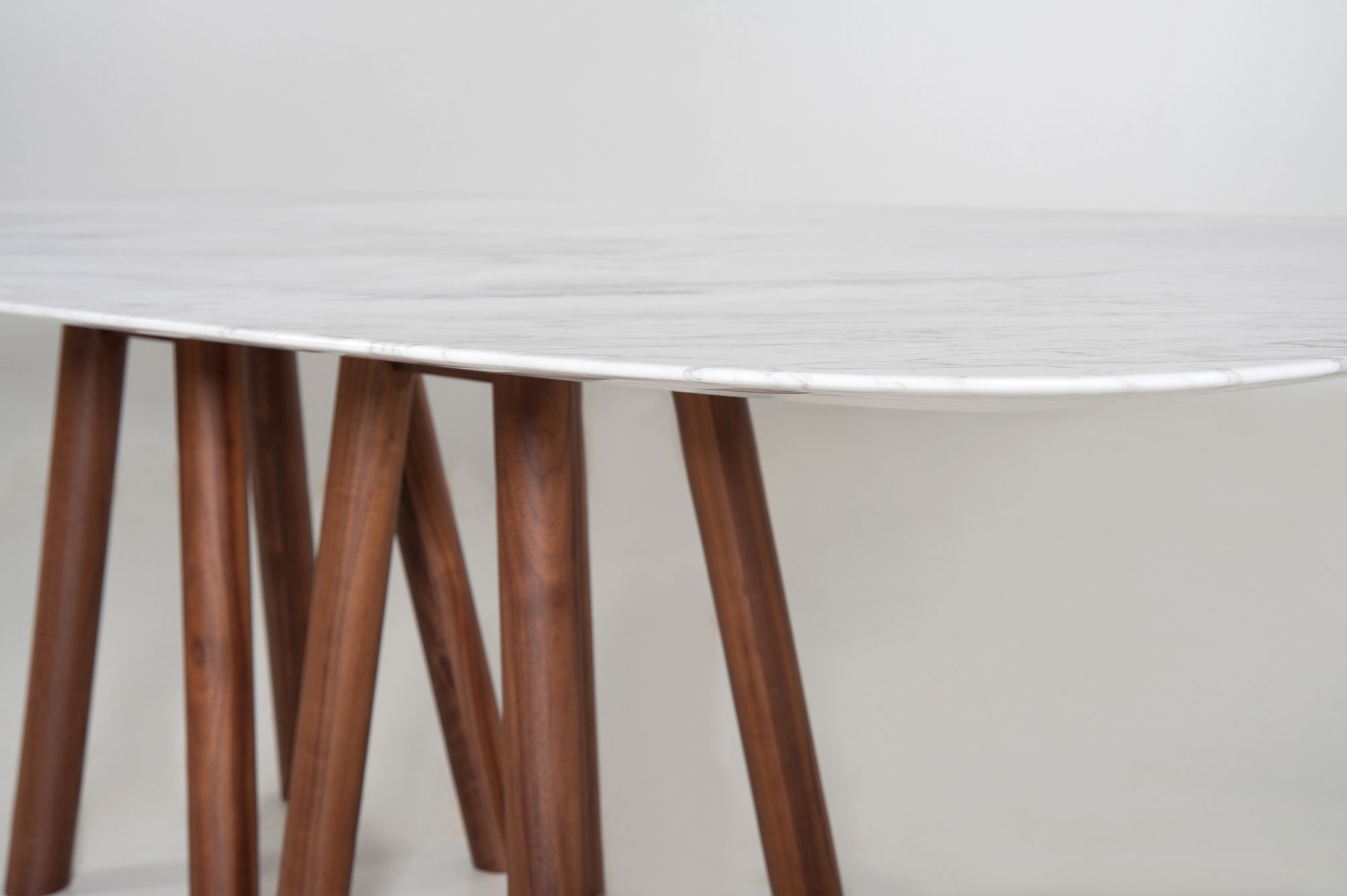 Mos-I-Ko 001 Fm Table - <p>Table in various sizes with shaped marble top - base<br /> with 8 legs in lacquered or solid wood.</p>  | Matter of Stuff