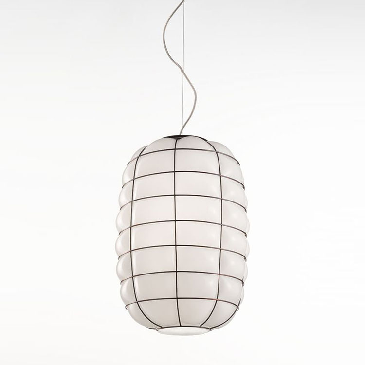 Lanterna Pendant Light - The Lanterna Pendant Light was an interpretation project that marries together the look of ancient Japanese paper and Venetian Glass. The glass has been blown so that it only just starts to come out from the steel frame to create a beautiful organic yet contained look. The glossy milk white finish of this light means that the soft light created will suit almost any room.  Hand made blown glass suspension with the techniques of the old Murano glass masters. Inputs 250V, uses 1X E27 max 100W ~ IP20 bulb  | Matter of Stuff