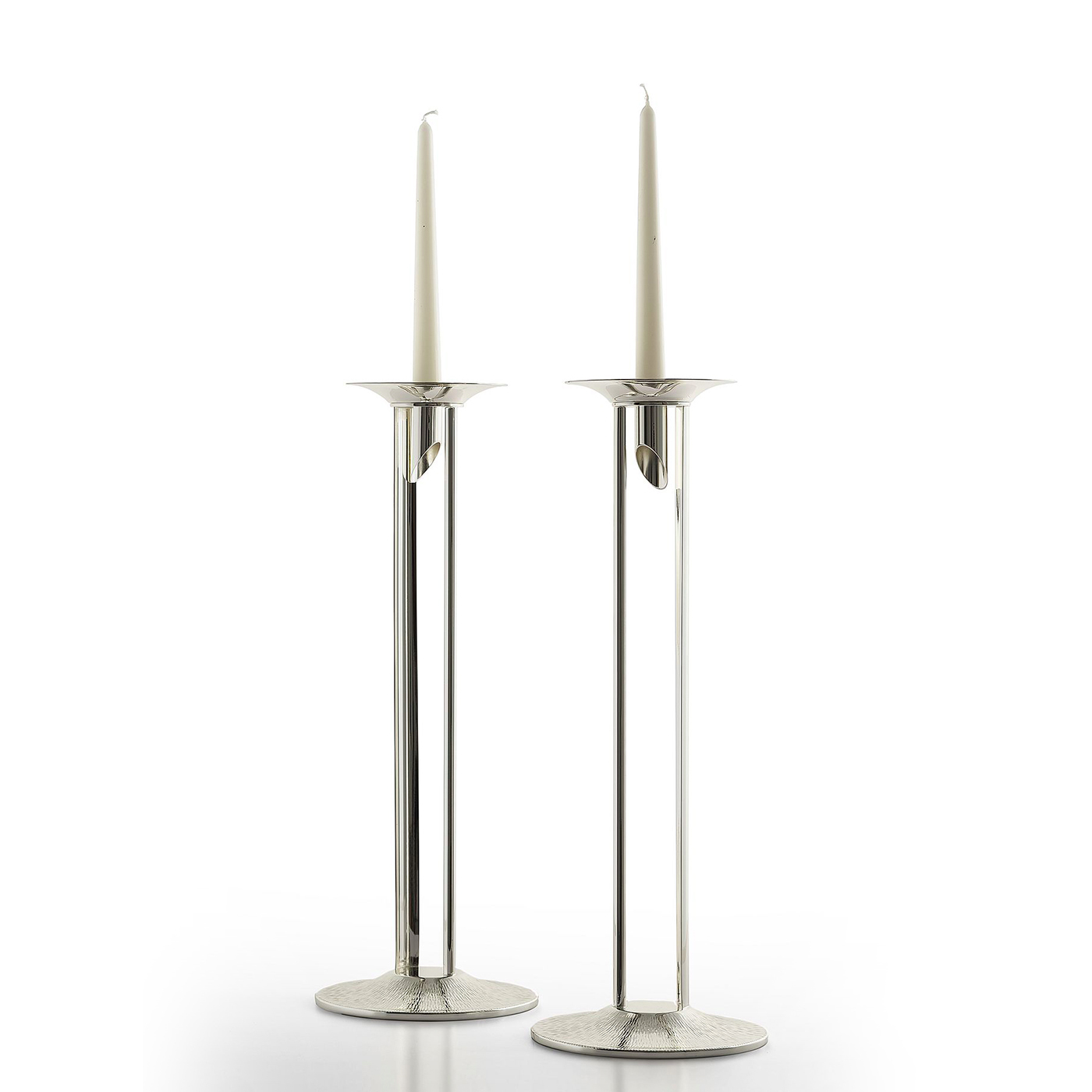 Disclosure Candleholders - This candle holder boasts an exquisitely modern and innovative design. The structure rests on a round base that has been turned and subsequently hammered by hand. It is topped with two pieces of semi-curved parallel plates that create a wonderful interplay of light that reflect off the smooth and hammered surfaces. The candle sits on a small hammered tray with a circular seat cut at the end at a 45-degree angle. Paired with a candle or as a unique sculpture, this piece will have highly decorative value showcased in any interior surface.  | Matter of Stuff