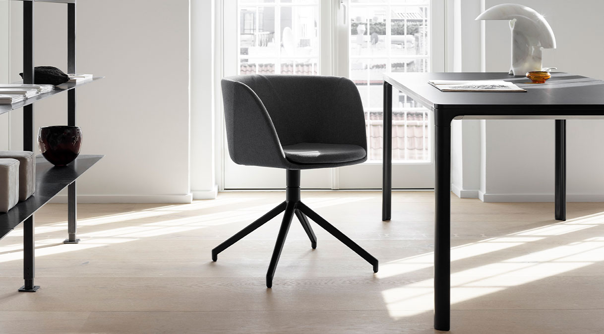 Mesa 4630 Table - With its slim 14 mm tabletop, Mesa is an understated line drawn through the room. The linoleum or laminate tabletop stands in sharp contrast to the soft curves of the aluminium frame and legs.