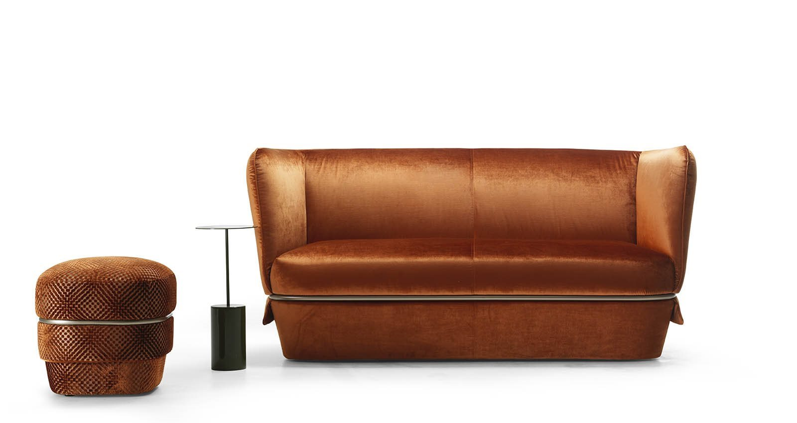 Chemise Sofa - Chemise sofa is one of the most iconic pieces of the entire MyHome collection with its soft and enveloping design. It is devised to express sophisticated and contemporary comfort, thanks to the abundance of fabric that upholsters the frame and a tubular loop-belt that accentuates its generous shape. The sofa is completed by the new ottoman version of Chemise: an object boasting a multitude of functions, sometimes used as a seat, and others as a footrest. Roundness appears to be the order of the day for this small furnishing which lends its surroundings fun and original style.  The Chemise sofa has a wooden frame covered with polyurethane foam and polyester fibre lining with a fabric cover   Matter of Stuff