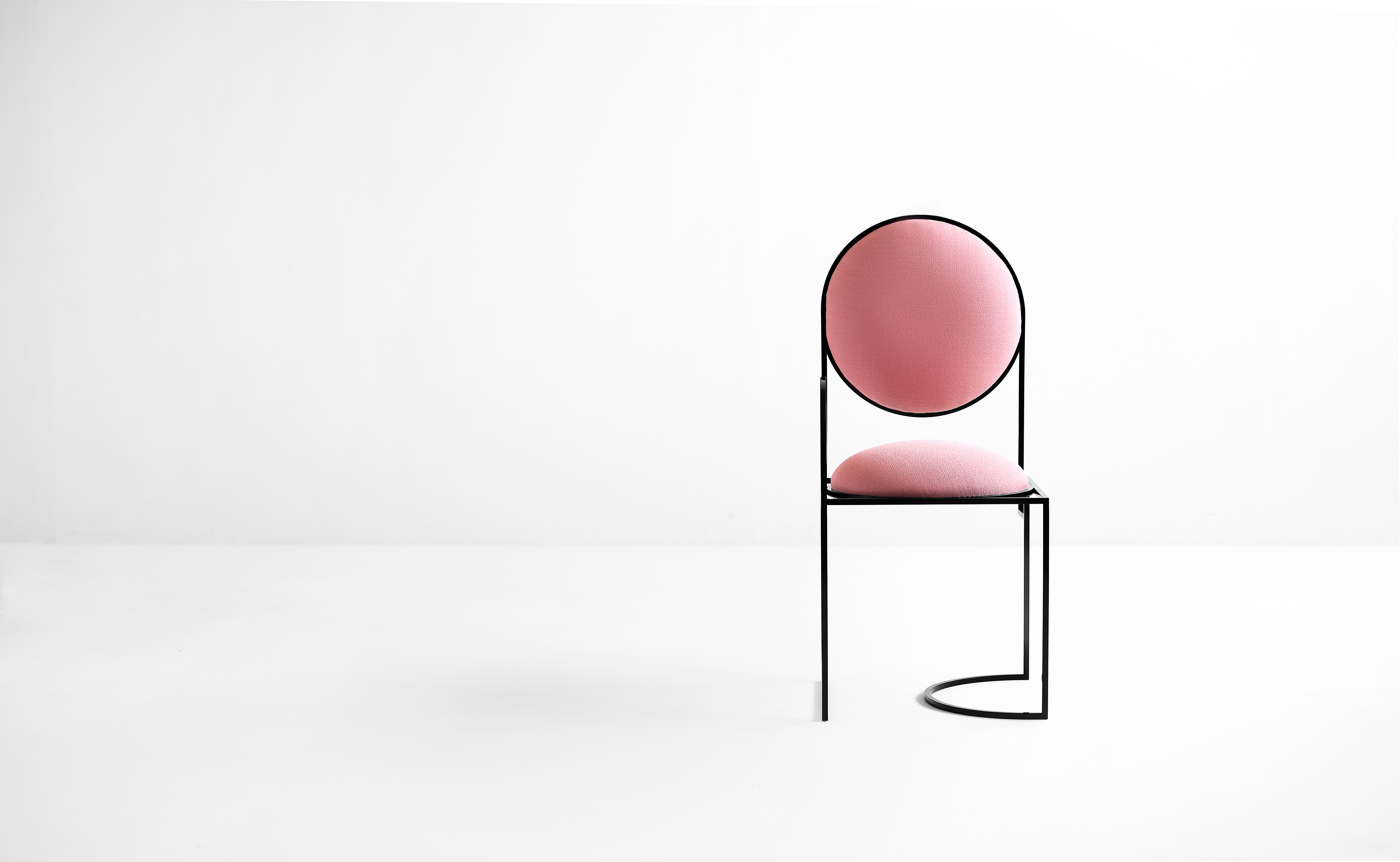 Solar Chair - The Solar Chair has an asymmetric frame and it's reflecting circles suggest the rising and setting of the sun. It is constructed from playful lines that incorporates circles, half circles and squares. 