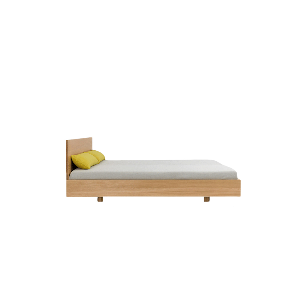 Simple Soft HI Bed - The bed SIMPLE HI is available in two heights of headboard: in the heights 67 cm and 79 cm. The puristic design of SIMPLE foregrounds the living material. The lightness of the construction is intensified by the floating frame. SIMPLE – the bed in the simplest form and function. SIMPLE HI – with a tall solid wood bedhead.  The Simple HI bed is available in white oiled ash, oiled oak, oiled knotty oak, colour stained oak, oiled American cherry, oiled American walnut and oiled European walnut.   Mattress size comes in L200 x W100, L200 x W120, L200 x W140, L200 x W160, L200 x W180, L200 × W200 cm.   Available in special sizes upon request.  Comfort height 40 cm (Bedside and feet each heightened 4 cm) is available at an additional charge.  the slatted base system is not included.   For colour stained oak options, please refer to the catalogue.   | Matter of Stuff