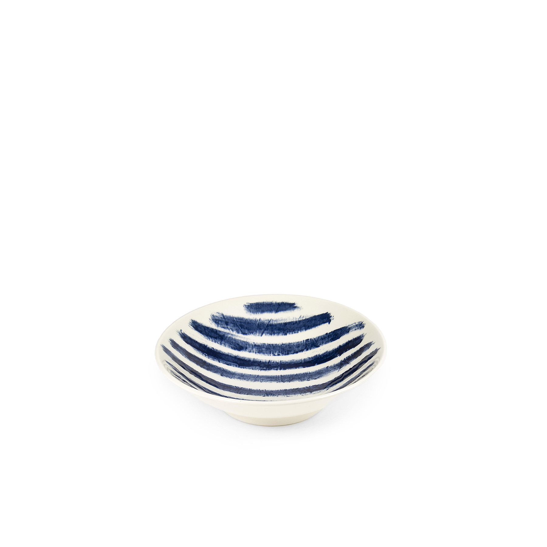 Indigo Rain Medium Serving Bowl - Faye Toogood's addition to her range of ceramic designs for 1882 Ltd. puts a fresh spin on the forms and traditions of English creamware. Indigo Rain reinterprets the homely familiarity of blue-and-white striped crockery in a new design informed by the spirit of serendipitous discovery. Representing a streamlined take on our ceramic heritage, the fine earthenware employs the familiar tones of English Delftware: cream offset with a rich, deep blue. Broad bands of indigo glaze, like painterly washes of watercolour, are applied to rough canvas and then transferred to the pieces – the characteristic grain of the fabric imbues the delicate ceramics with the hardworking spirit of dark-dyed denim.  | Matter of Stuff