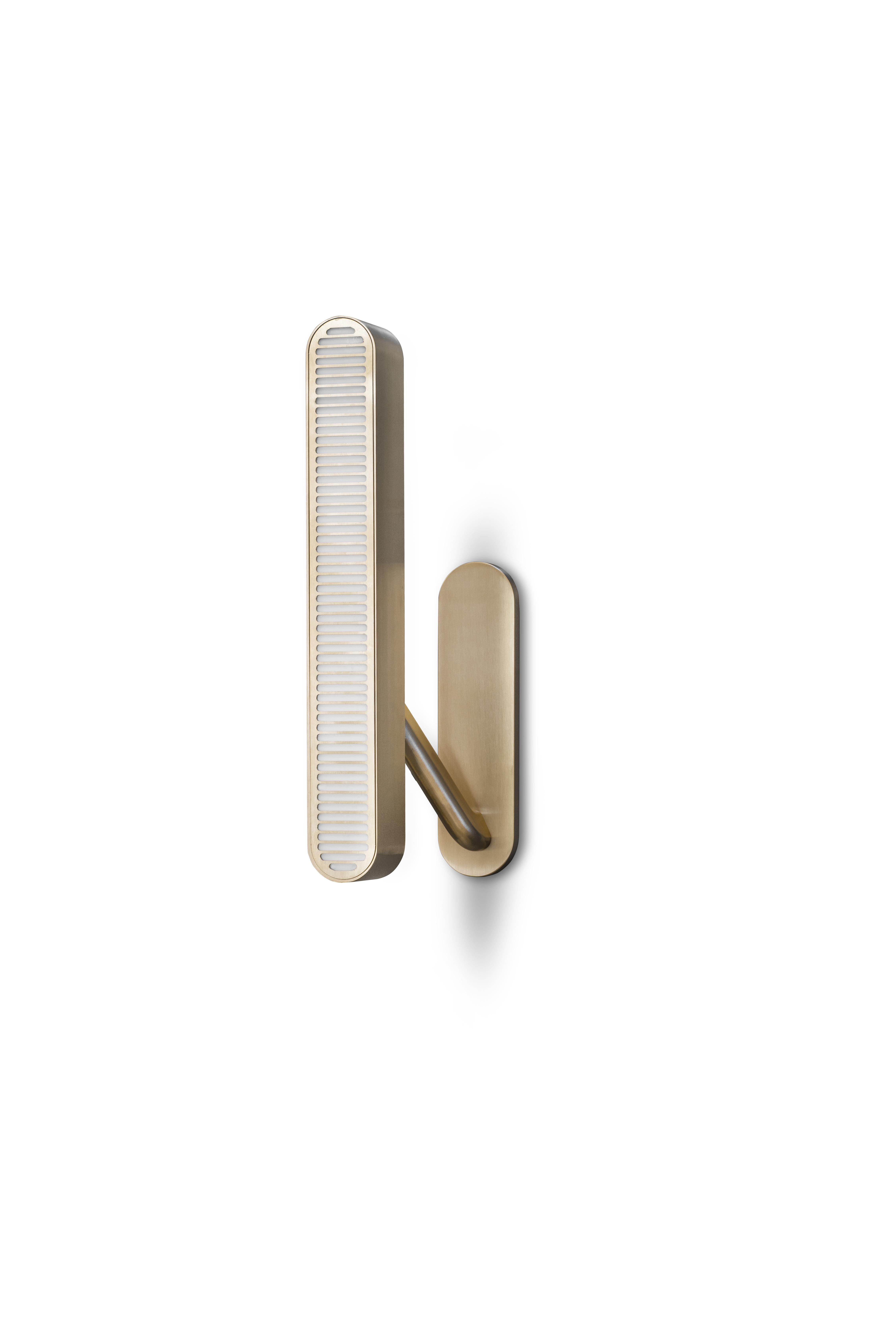 Colt Wall Light - Single - Crafted from machined brass, a sleek slotted grill sits atop an opal diffuser in Bert Frank's Colt Wall Light. With contrasting bronze inserts on the arm it casts a warm wash of light on both the wall and into the room.   | Matter of Stuff