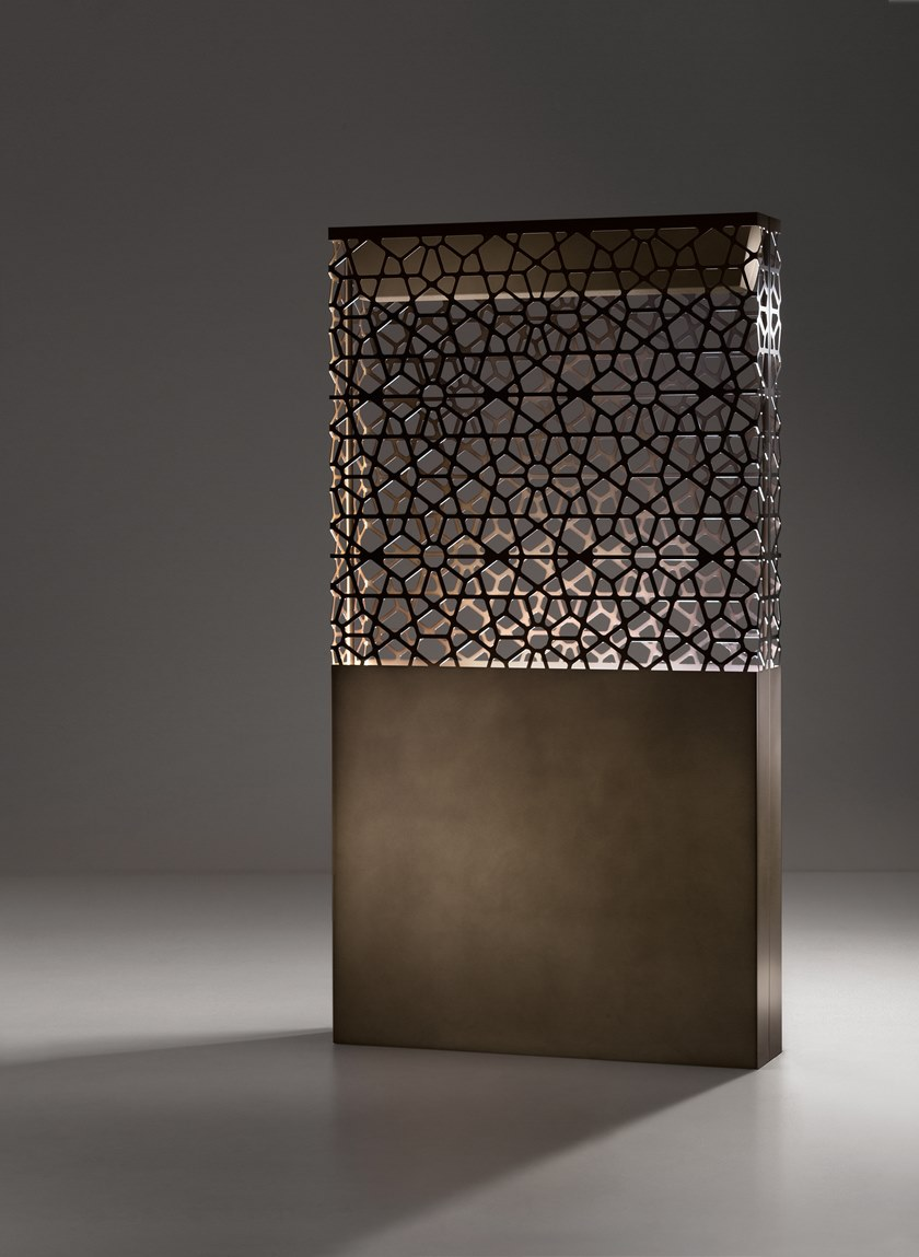 Dafne & Demetra Floor Lamp - Partition, lamp or planter, these bright objects can decorate indoor and outdoor spaces. Three different functions come together in a single element characterized by a refined geometric pattern, filtering light. The solid, compact base, which can be secured to the ground, is juxtaposed with an upper section where a pattern covers and lightens the structure, diffusing light and welcoming its green soul. | Matter of Stuff
