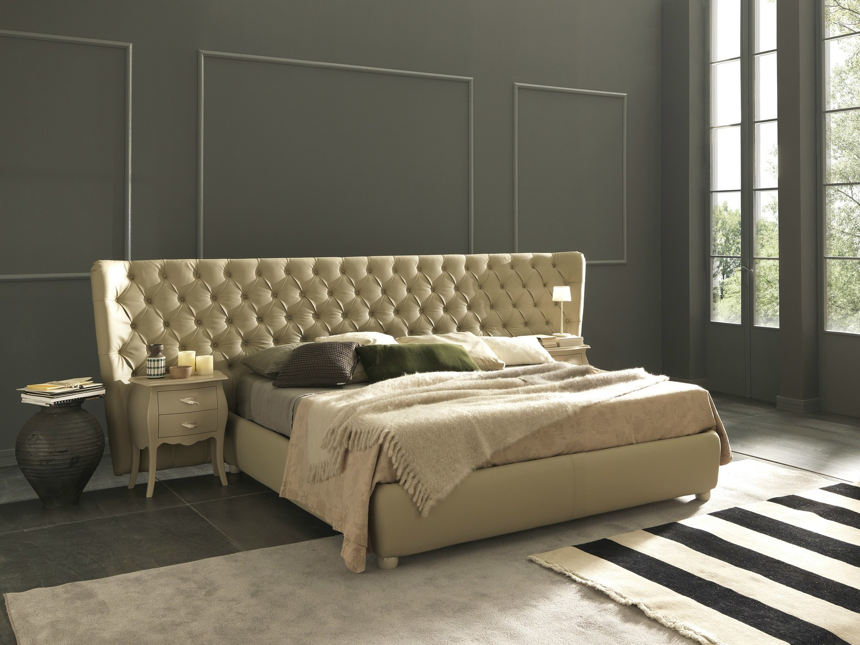 Selene Extra Large Bed with Tufted Headboard - Selene Extra Large features an extra-wide headboard. The squared shapes gain lightness thanks to the round feet that recall the sinuous quilting on the headboard and the graceful shapes of Venice night table.  Fir structure - Aluminum available on request Standard feet vasetto - non-removable headboard Variants: with H 29 bed frame / with H 29 box / with H 29 easy up box  All beds are available in different sizes and frame options. Please enquire for more details.  | Matter of Stuff