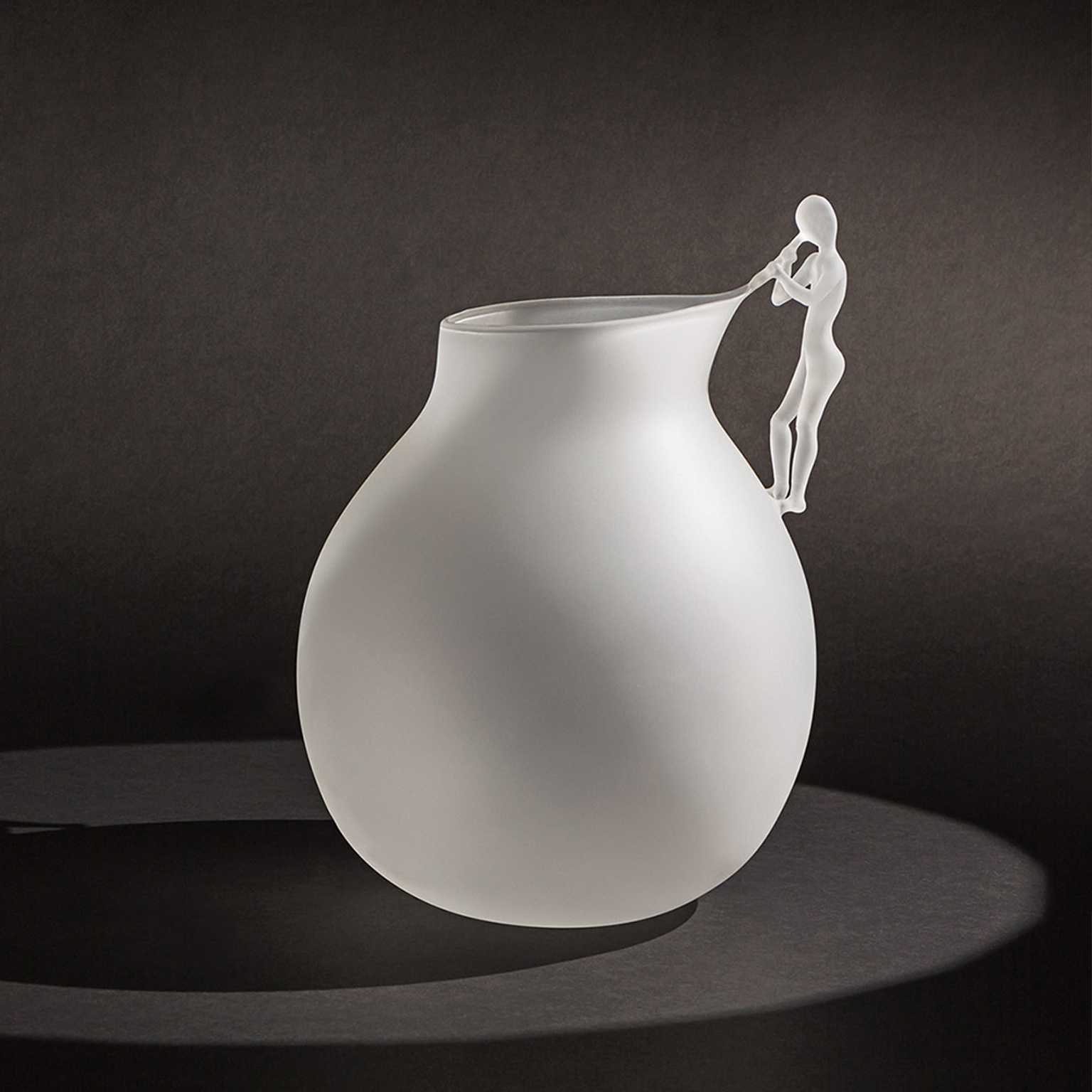 "The Blowing Man Vase - The Blowing Man is a collection of 5 pieces in hand blown borosilicate glass in limited edition of 29 pieces, the story through the poetic and oneiric interpretation of the art of glass blowing.The collection becomes the theatre where ""man"" is once again the protagonist together with the object, and through the object itself, in a game of light and shadows that highlight the high-end handwork through the poetry of gestures delicate like breaths.  