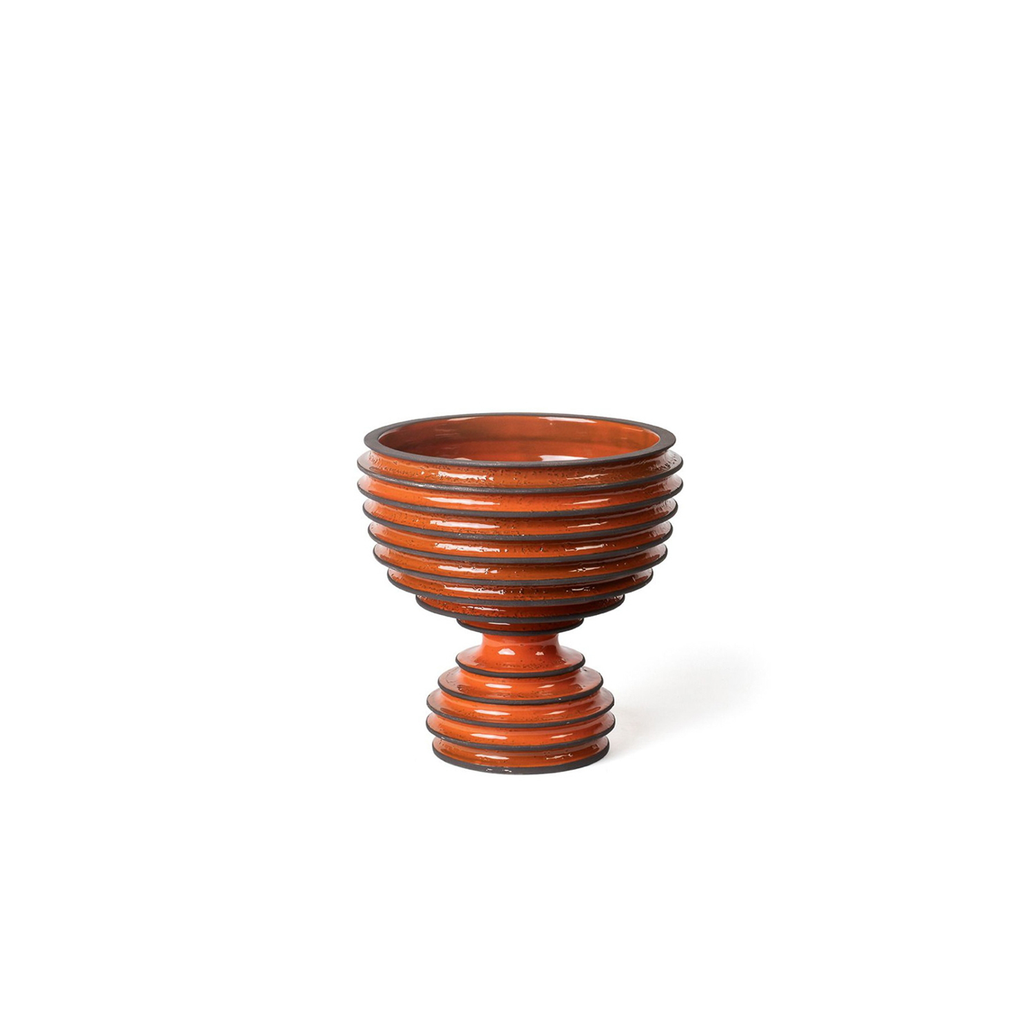 Revolver Orange Goblet - A traditional design dressed in a stylish contemporary suite, this ceramic goblet is part of the exclusive Revolver Collection, showcased at Milan Design Week in 2019. The hourglass-shaped, orange-hued silhouette features a spacious bowl resting on a convex base, both distinguished by a deeply ribbed texture accented by brown edges.