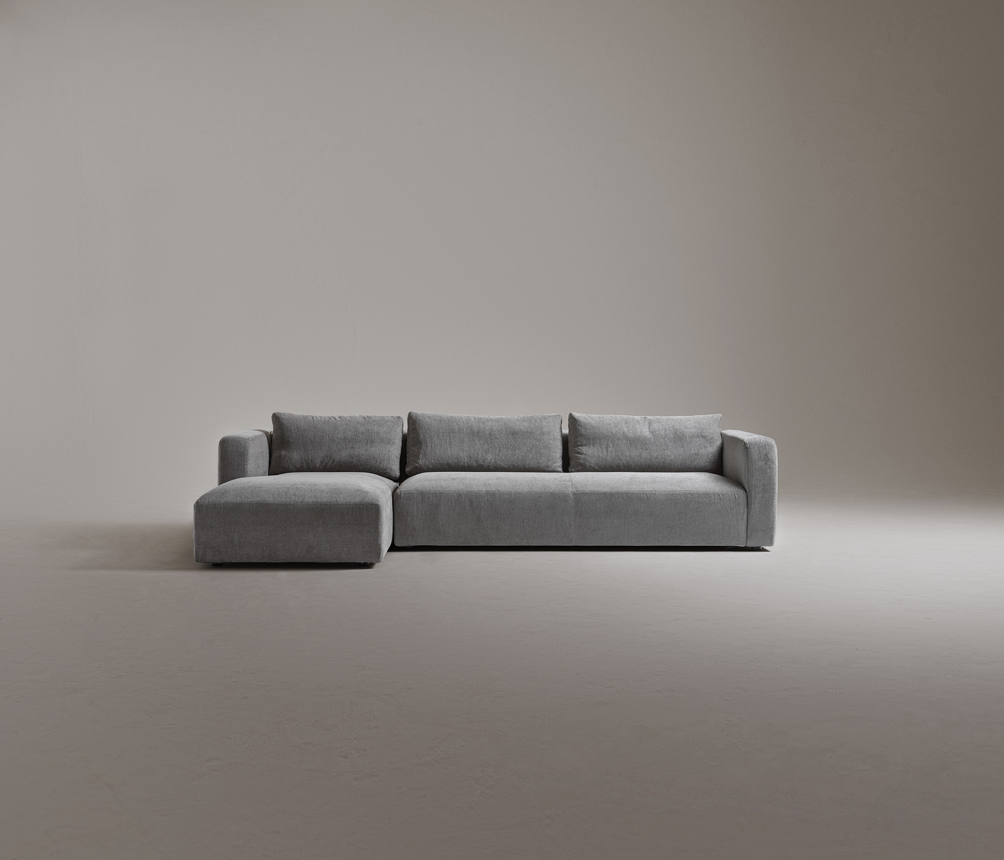 Softly Modular Sofa - Soft and cosy, an informal modular sofa featuring a generous and sumptuous seat cushion which adapts to the body, for remarkable comfort. A product that will fit in with any style of home. Softly is a sofa with a wooden frame covered in non-deformable polyurethane foam and polyester fibre lining. The seat is made of non-deformable polyurethane foam of different densities and polyester fibre lining. Removable fabric or leather or raw leather edges cut covers. This sofa is a modular sofa so there are different combinations available. Please enquire for more information and prices. | Matter of Stuff