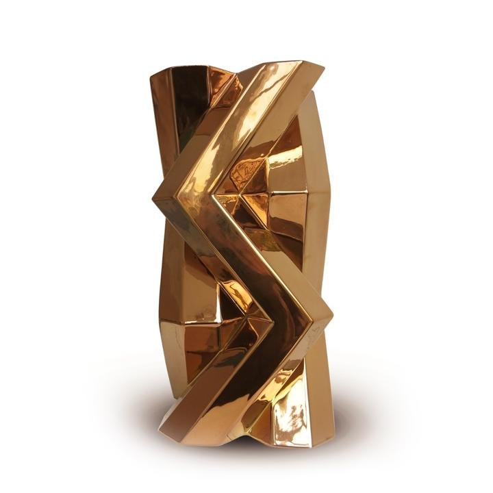 Fortress Tower Vase Dark Gold - <p>Designer Lara Bohinc explores the marriage of ancient and futuristic form in the new Fortress Vase range, which has created a more complex geometric and modern structure from the original inspiration of the octagonal towers at the Diocletian Palace in Croatia. The resulting hexagonal blocks interlock and embrace to allow the play of light and shade on the many surfaces and angles. These are handmade from ceramic in a small Italian artisanal workshop and come in different finishes.</p>  | Matter of Stuff