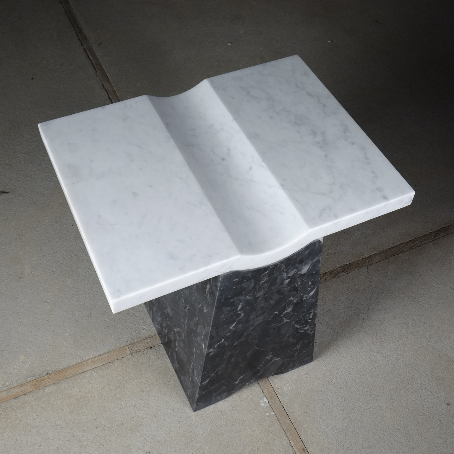 Coulee Side Table - <p>The distinguishing feature of the Coulee side table is the subtle recessed curve, that can be used as an organiser and container for displaying small goods, coins, cell phone, keys, flowers. Coulee uses two heavyweight pieces, creating a stable structure by joining complimenting geometry where the table becomes a singular mass/volume/sculpture.<br /> Developed and Produced during the Matter of Stuff Designer Residency program in Montalcino</p>  | Matter of Stuff
