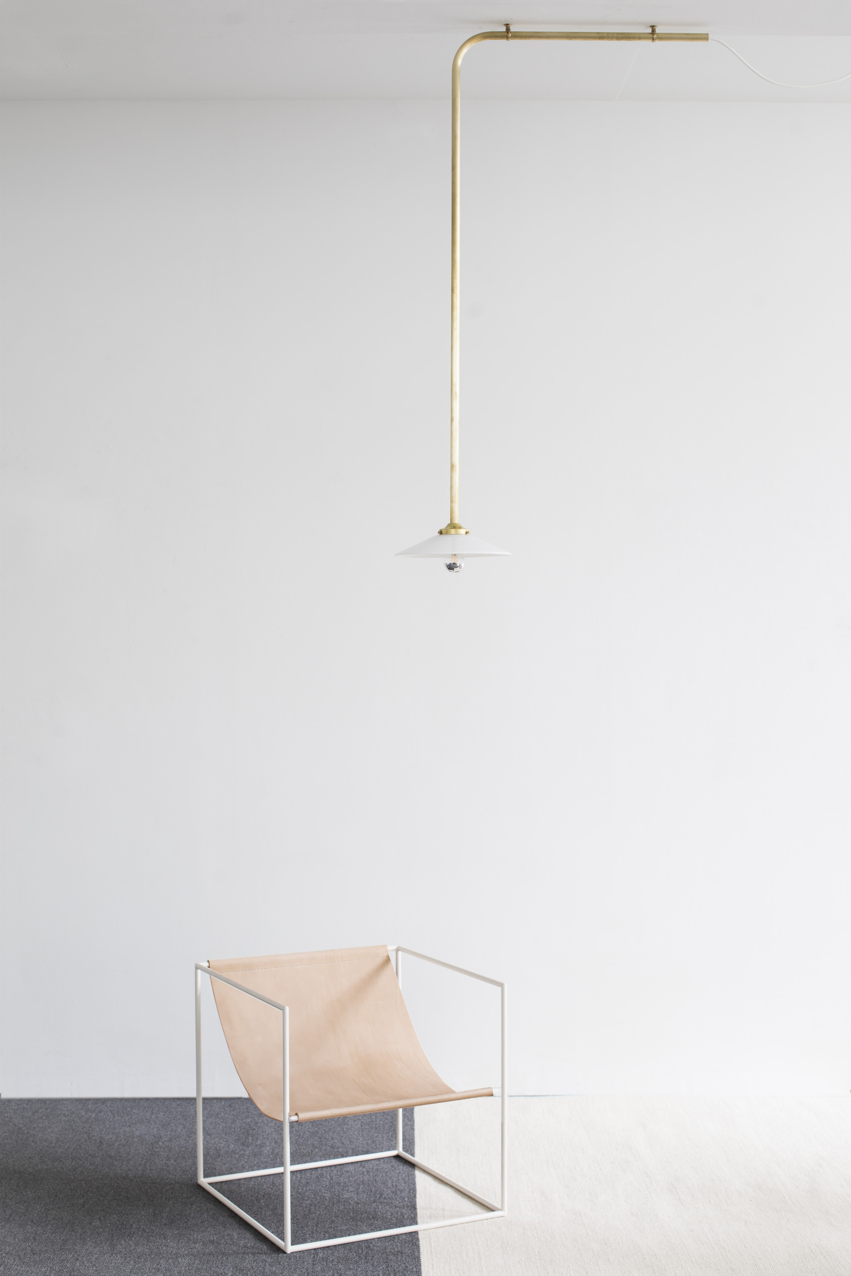 Solo Seat - <p>This solo seat is a core version of the famous duo seat that Muller Van Severen presented in 2012 during their break-through show at Interieur Kortrijk. The basic concept remains the same: creating a seat that consists of nothing more than a cloth and a steel frame. The cloth is made from bleak leather that ages beautifully over the years, the frame comes in two colors: white and a nice red. Both colours match perfectly with the leather.</p>  | Matter of Stuff