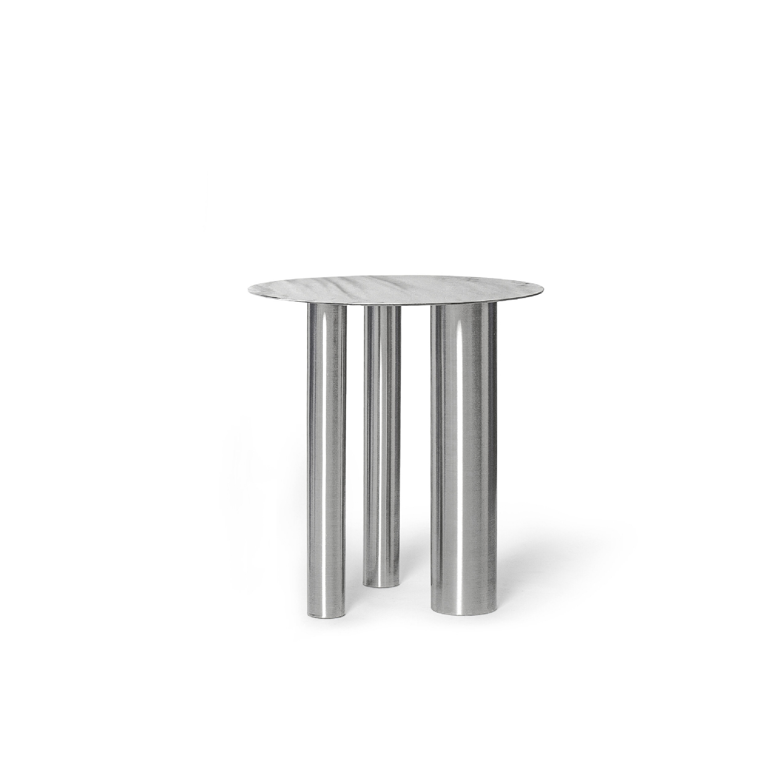 High Coffee Table Brandt CS1 - While looking at these tables for the first time, you get the feeling that the basic element of the interior is clear, familiar and understandable. However, the things in this edition are universal only in their functionality.   The aesthetic game with geometry typical for the NOOM brand makes accents on familiar items. The tabletop is held by three cylindrical legs of different diameters. This gives asymmetry to the model, however, as much as it is appropriate in a concise manner.  Hand brushed pattern on the metal surface looks like ripples on the water.  Color Scheme: CS1 - Hand brushed stainless steel | Matter of Stuff
