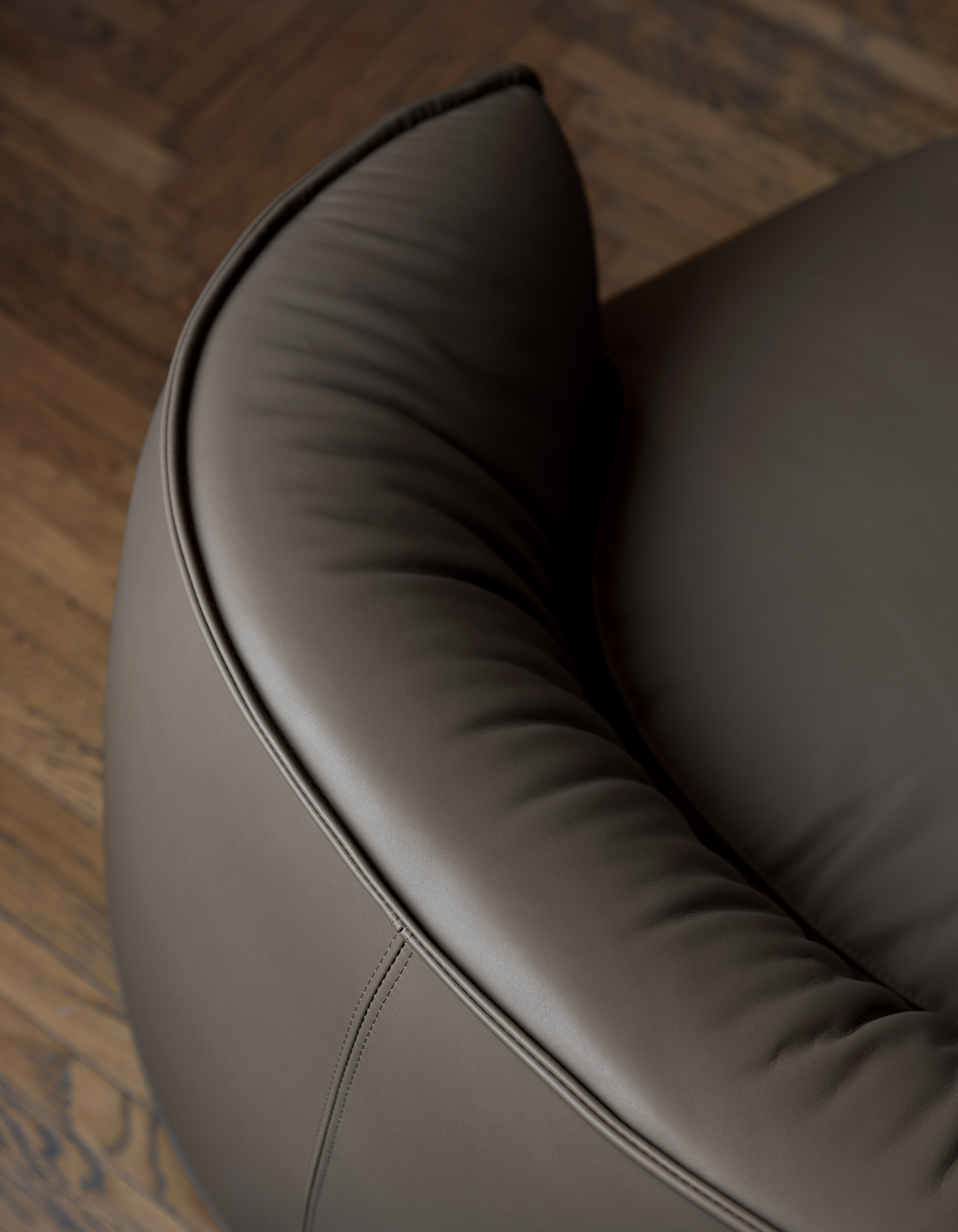 Brioni Small Lounge Chair - Brioni is a collection of poufs, lounge armchairs and daybeds named after a famous archipelago in the Adriatic Sea. They resemble small islands rising out of the sea. Their design features a dark band on the lower part that prevents direct contact between the ground and the upholstery. The upholstery is made of Sunbrella fabric: stain-resistant, breathable, resistant to UV rays and water-repellent. They are soft and comfortable thanks to flexible polyester padding and plastic slats, enclosed in water-resistant housing. Light and easy to move, they can be used to create countless compositions outdoors, experimenting with different shapes, colours and sizes. <p>A range of materials are available in a number of combinations. Prices may vary. Please enquire for full details. | Matter of Stuff